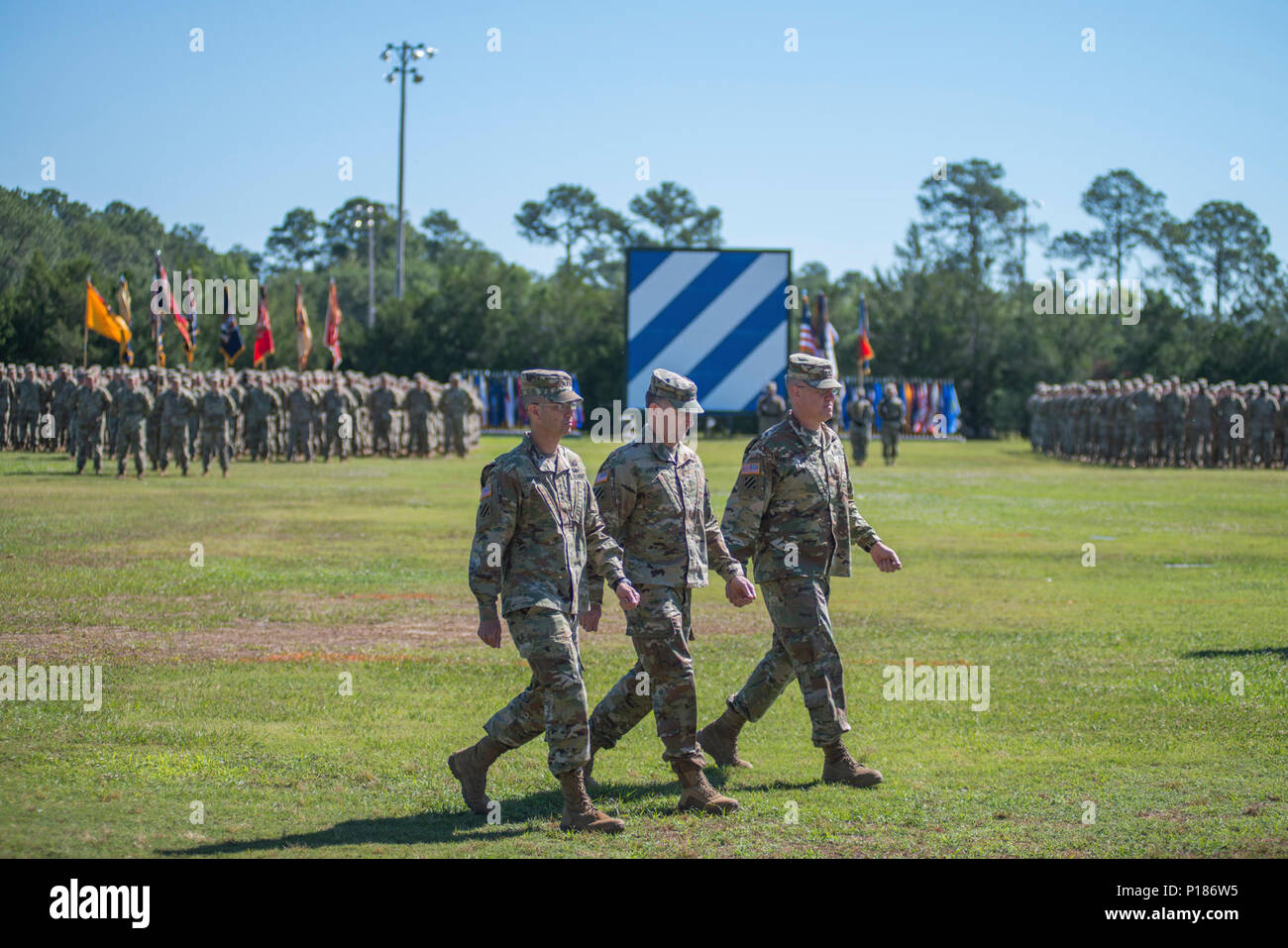 Maj. Gen. Leopoldo Quintas, left, incoming Commander of 3rd Infantry Division, Gen. Robert Abrams, center, Commander U.S. Forces Command, and Maj. Gen. James Rainey, right, outgoing Commanding General 3rd Infantry Division, complete the inspection of troops. The 3rd Infantry Division change of command ceremony was held on Cotrell Field at Fort Stewart, GA, May 8, 2017. Stock Photo