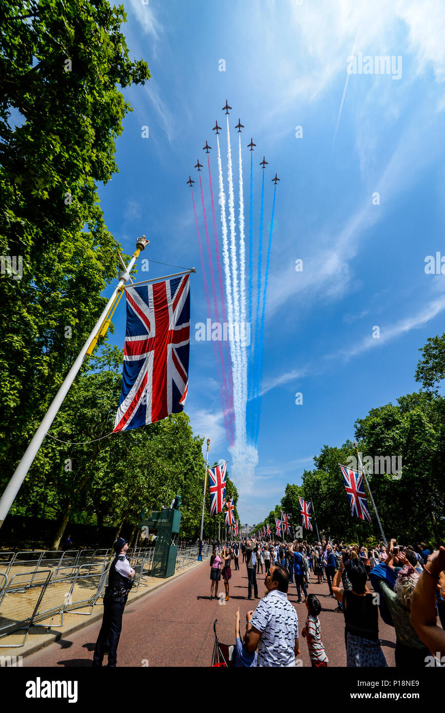 British Red Arrows of the Royal Air Force flying down The Mall for Queen's Birthday Flypast over London after Trooping the Colour 2018. People watch Stock Photo
