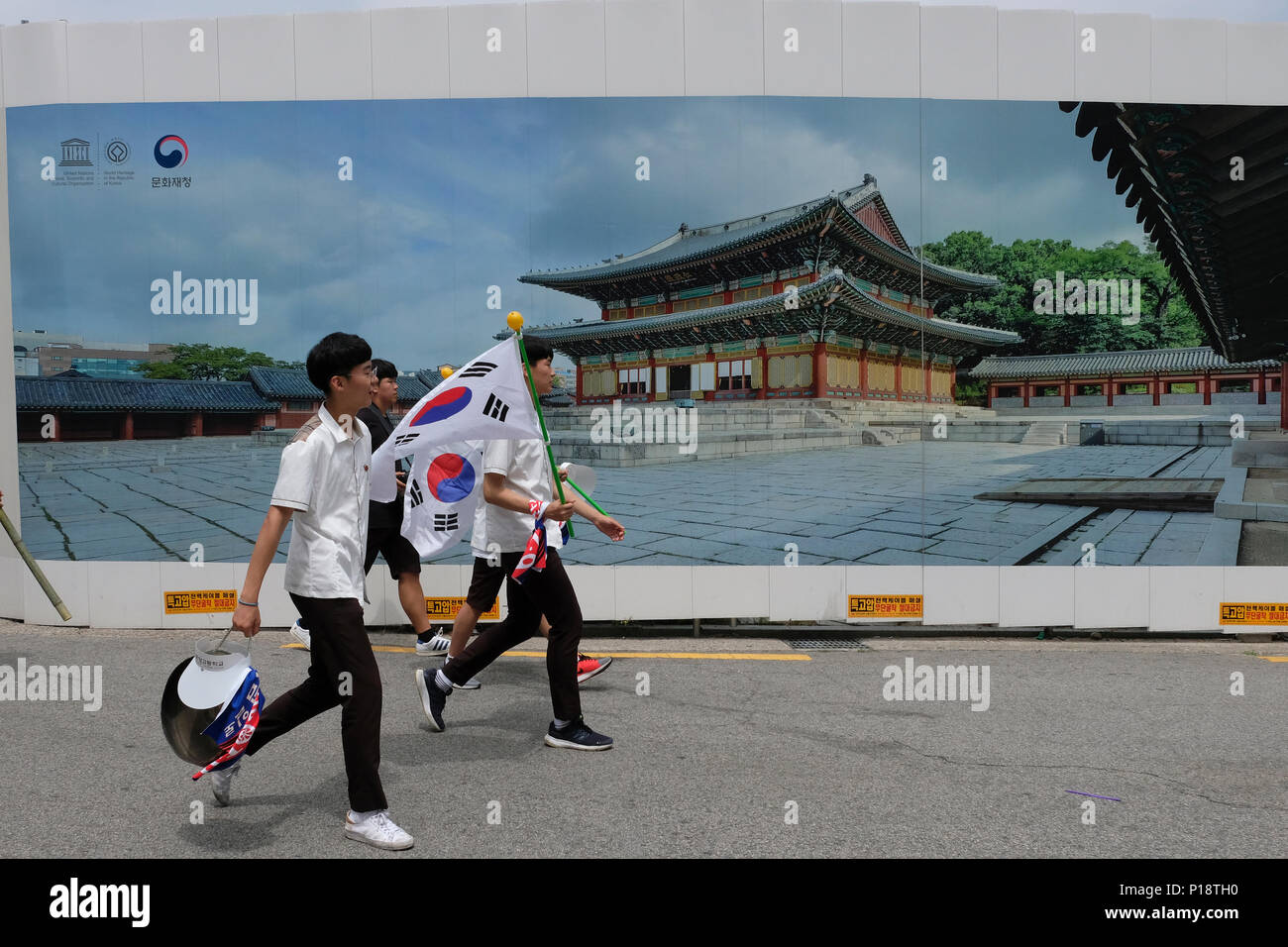 Korean schoolchildren holding South Korean flags reenact the March 1st Movement, also known as Sam-il Movement against Japanese colonial rule that occurred on March 1, 1919, hence the movement's name, in the city of Seoul capital of South Korea Stock Photo