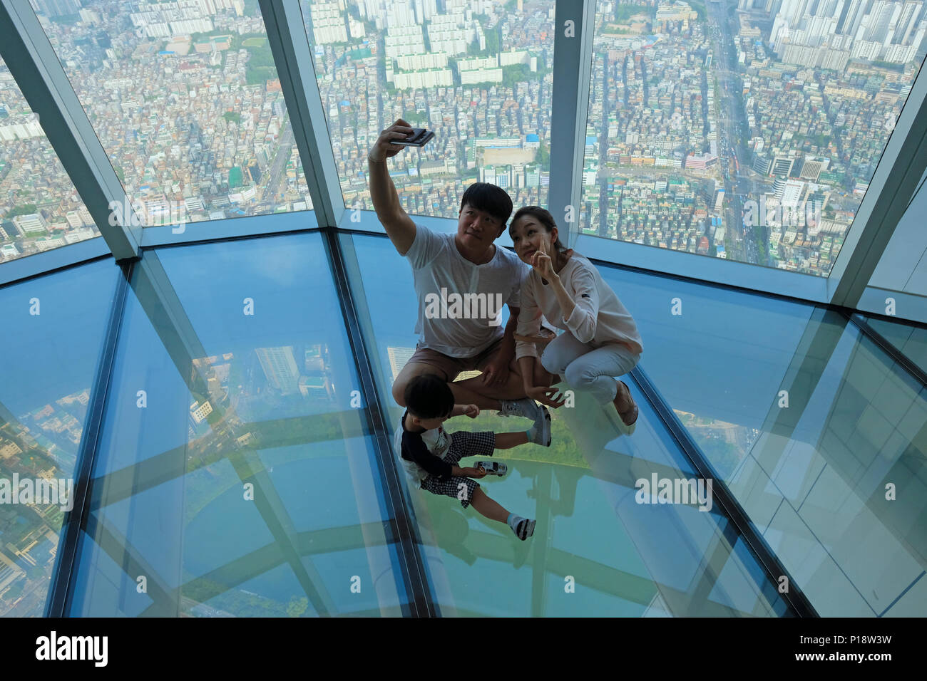 A Korean Family Taking Selfie Photo At The Glass Floor Observatory