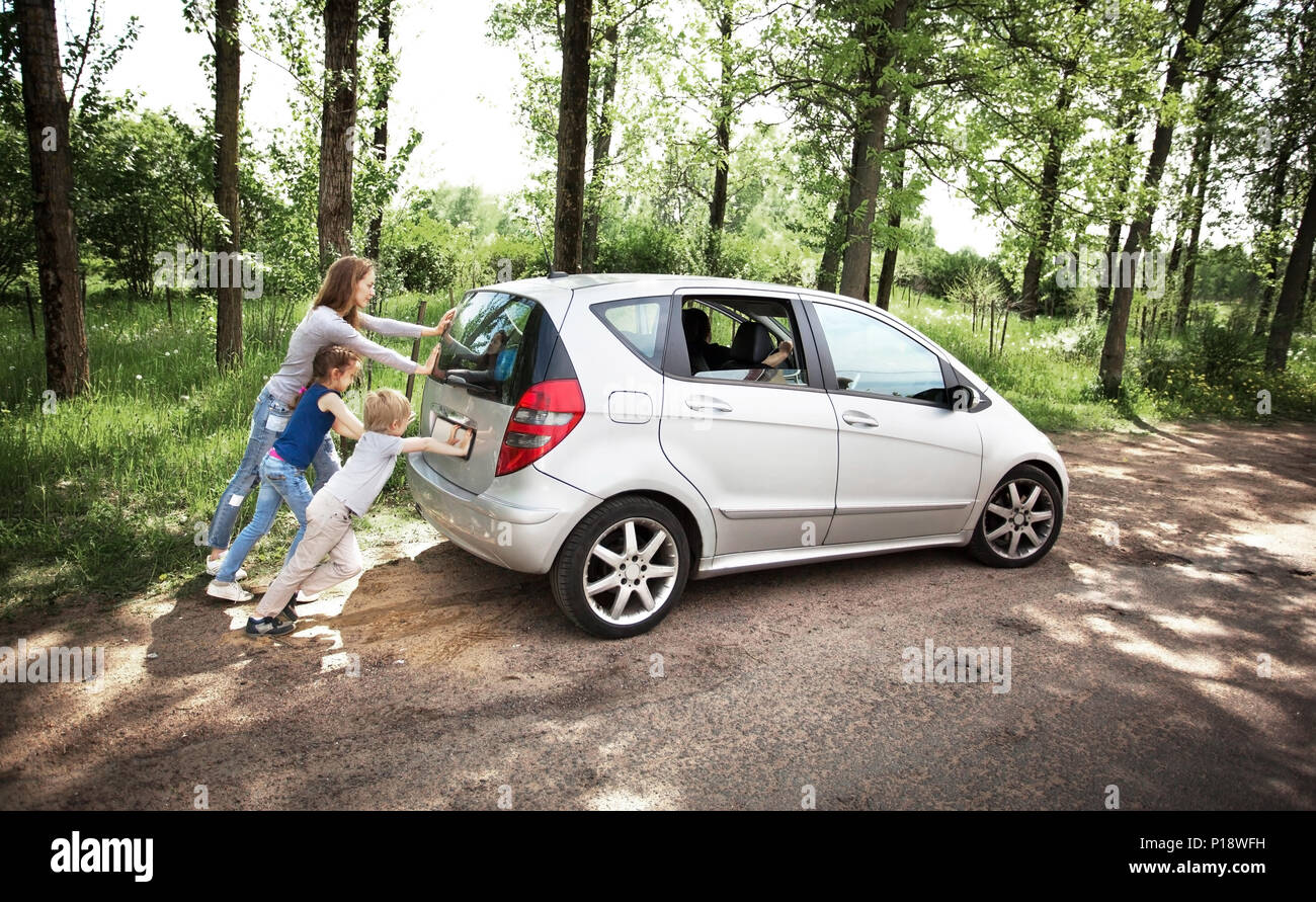 Fun friendly family is on a picnic. A car breakdown. - Stock Image