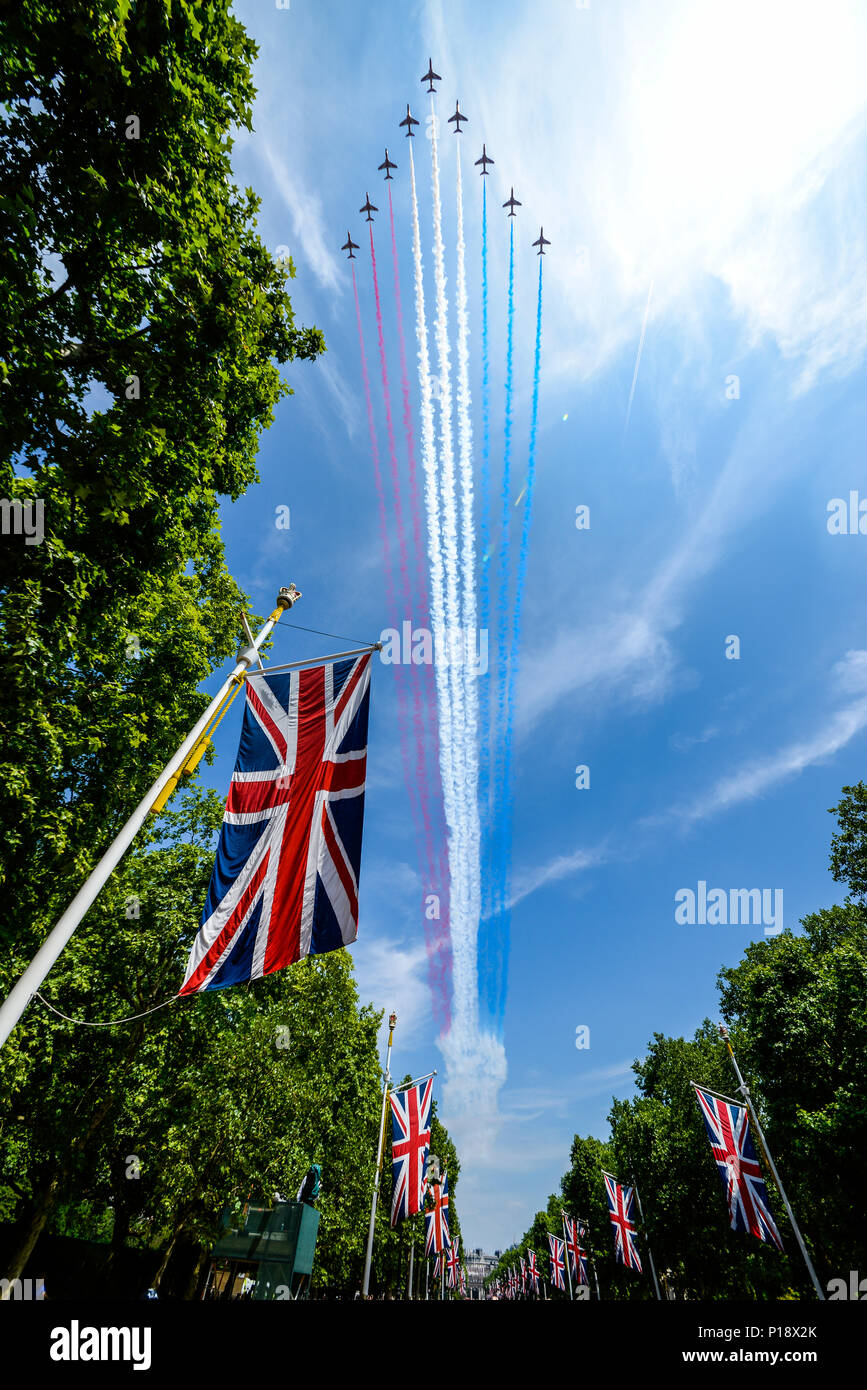 Red Arrows of the Royal Air Force flying down The Mall for Queen's Birthday Flypast over London after Trooping the Colour 2018. British flag Stock Photo