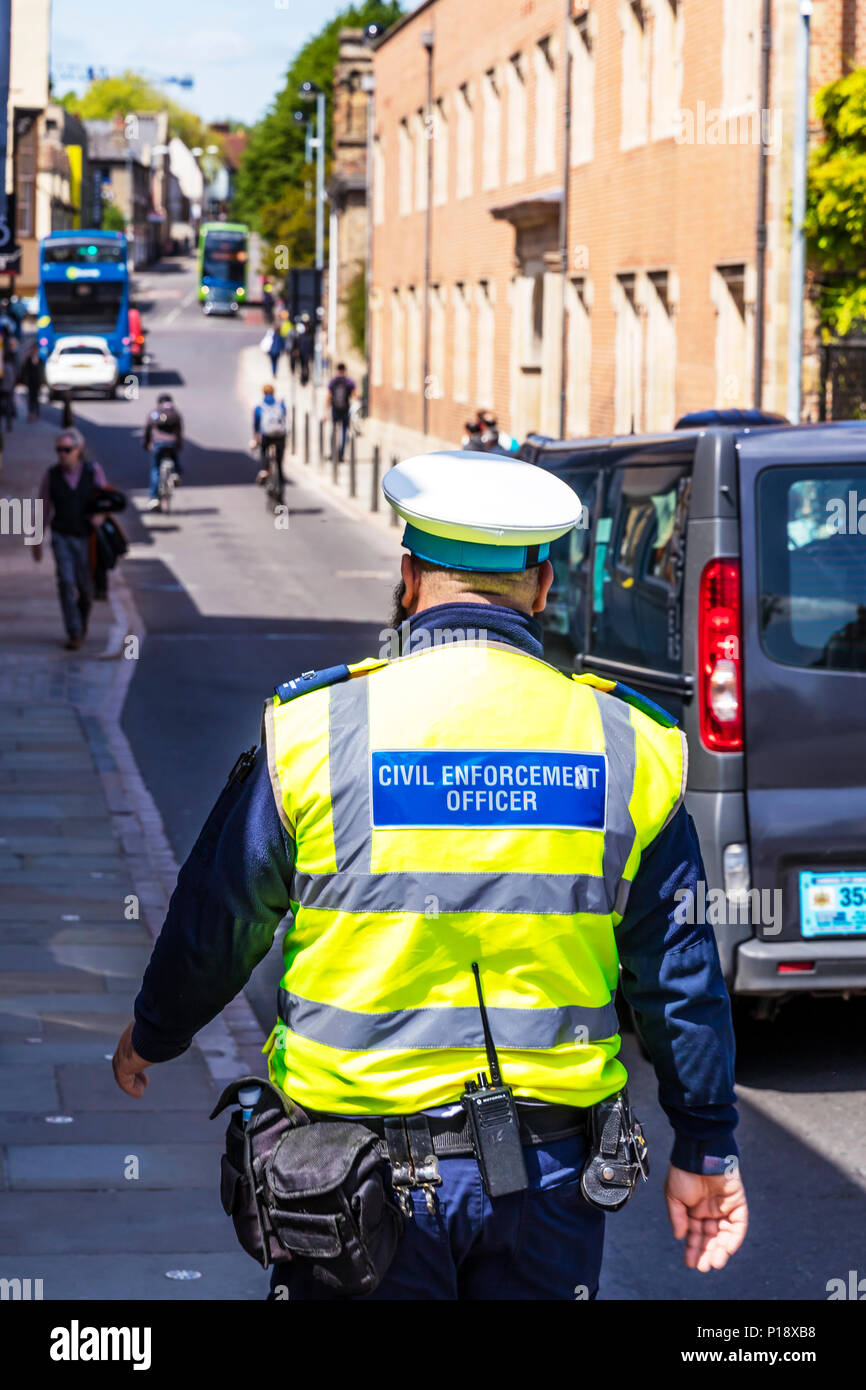 Civil Enforcement Officer, CEO traffic warden, employed to enforce parking, CEO, CEO UK, traffic warden, traffic warden UK, UK traffic warden, Stock Photo