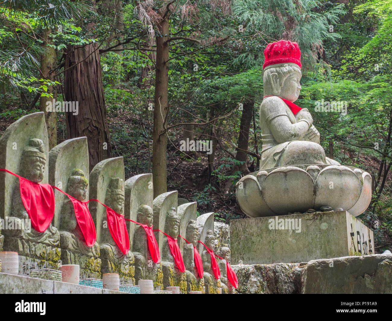 Buddhist deities, statues with red bibs, Taisanji temple 52,  Shikoku 88 Temple  pilgrimage,   Ehime, Japan. - Stock Image