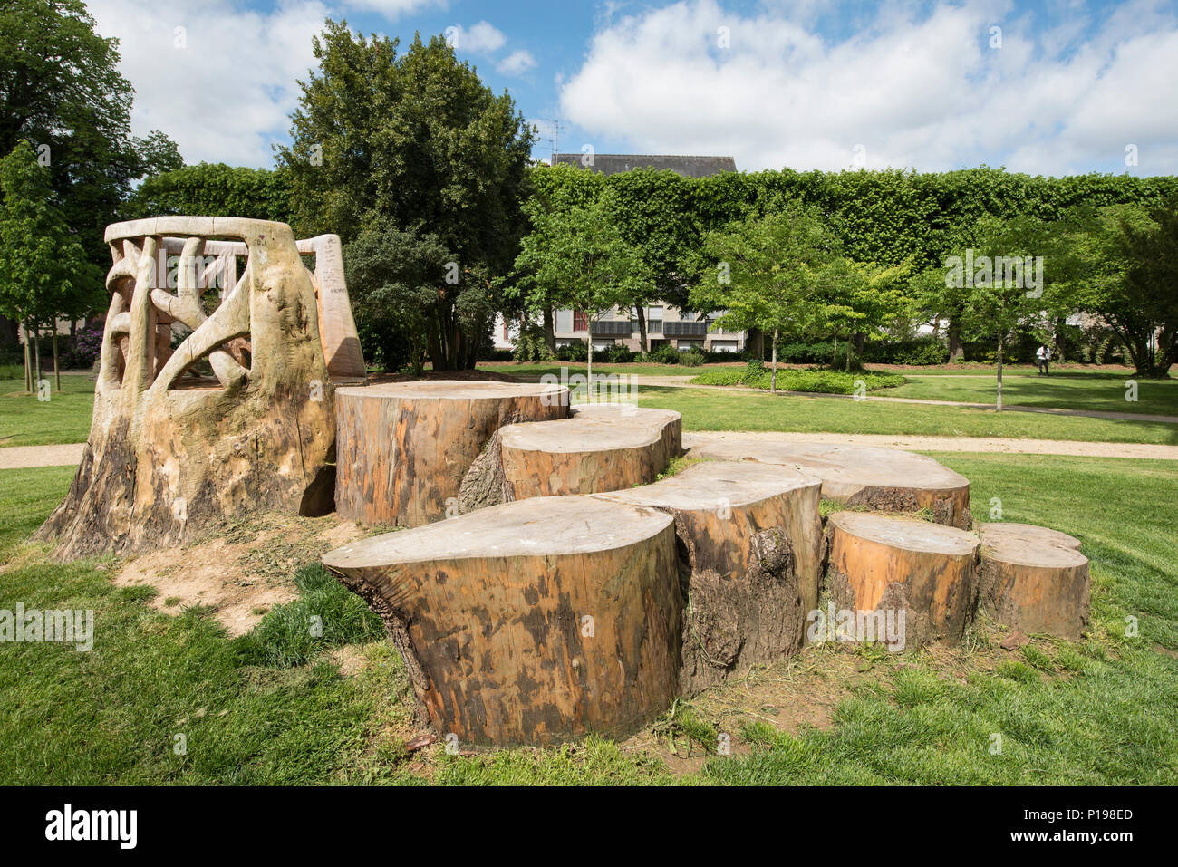 Pulpit made from tree stumps in the grounds of Imperial church of Saint Joseph ( Eglise impériale Saint-Joseph ), Pontivy, Morbihan, Brittany, France. - Stock Image
