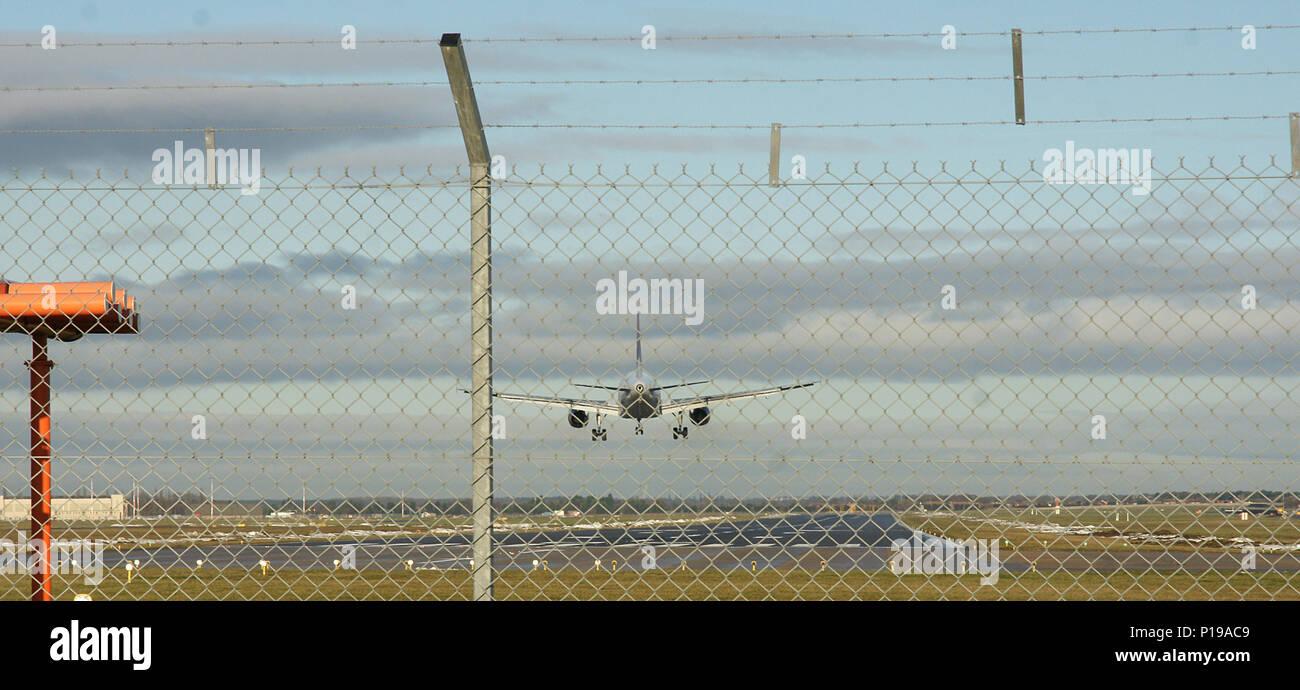 passenger aircraft landing at airport - Stock Image