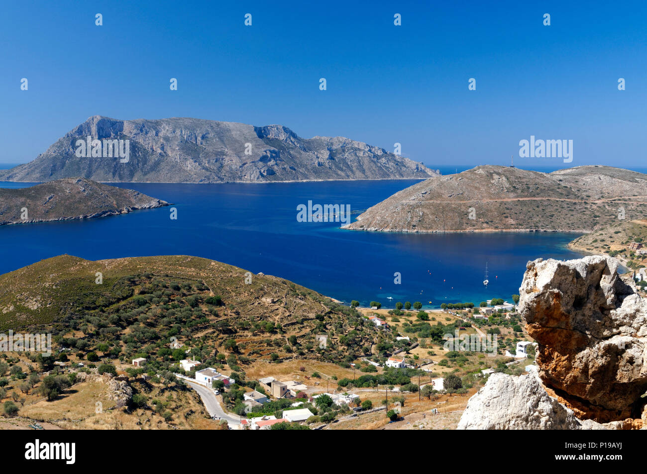 View of Telendos Island from mountains above Emborios, Kalymnos, Dodecanese Islands, Greece. - Stock Image