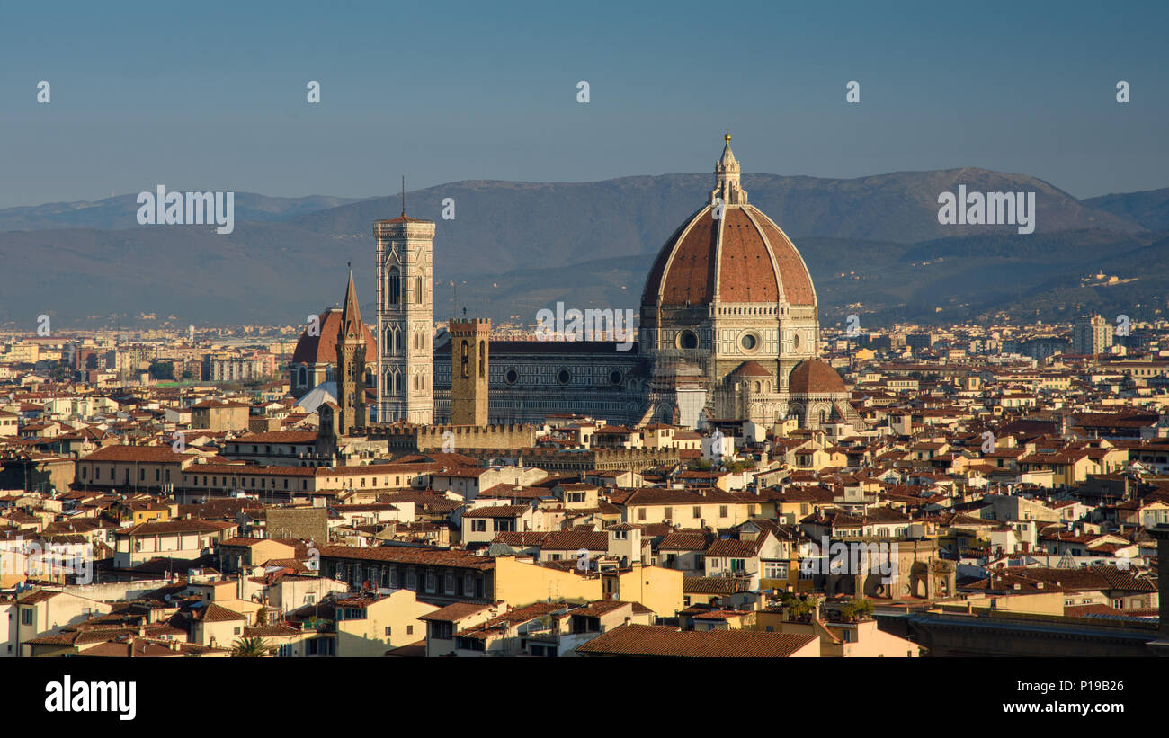 Florence, Italy - March 24, 2018: Morning light illuminates the cityscape of Florence, including the historic landmark of the Duomo cathedral. - Stock Image