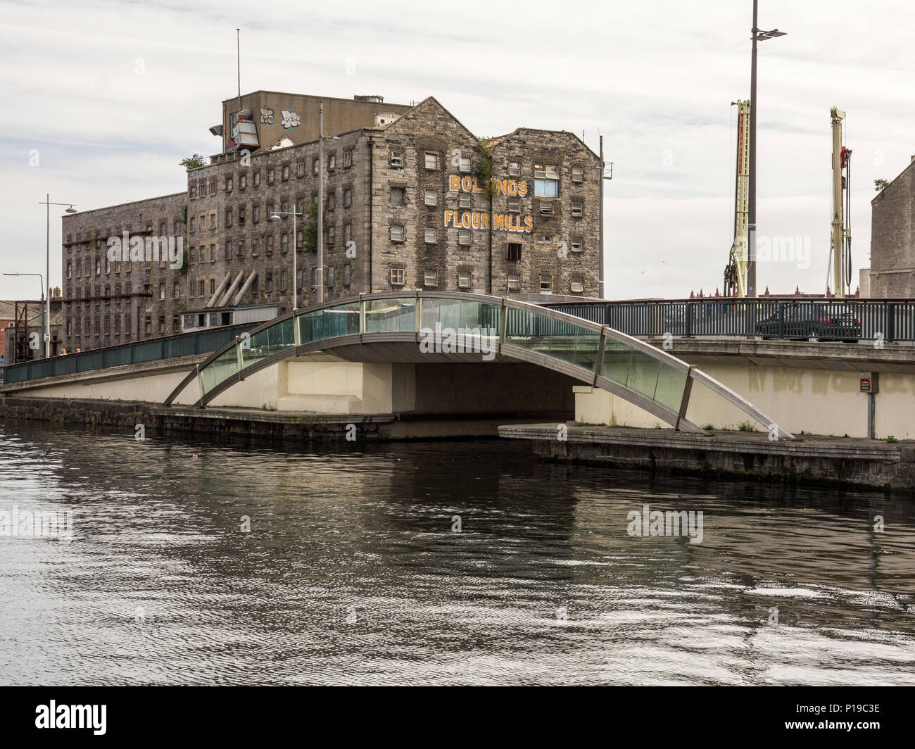 Dublin, Ireland - September 17, 2016: Old warehouse buildings on the Grand Canal Dock in Dublin's regenerating Docklands district. - Stock Image