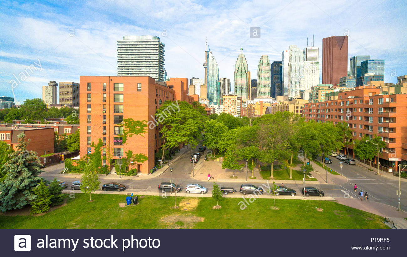 Bird view of the Canadian city downtown. Drone point of view from Old Toronto in the West toward the downtown district in the East. The CN tower can b - Stock Image