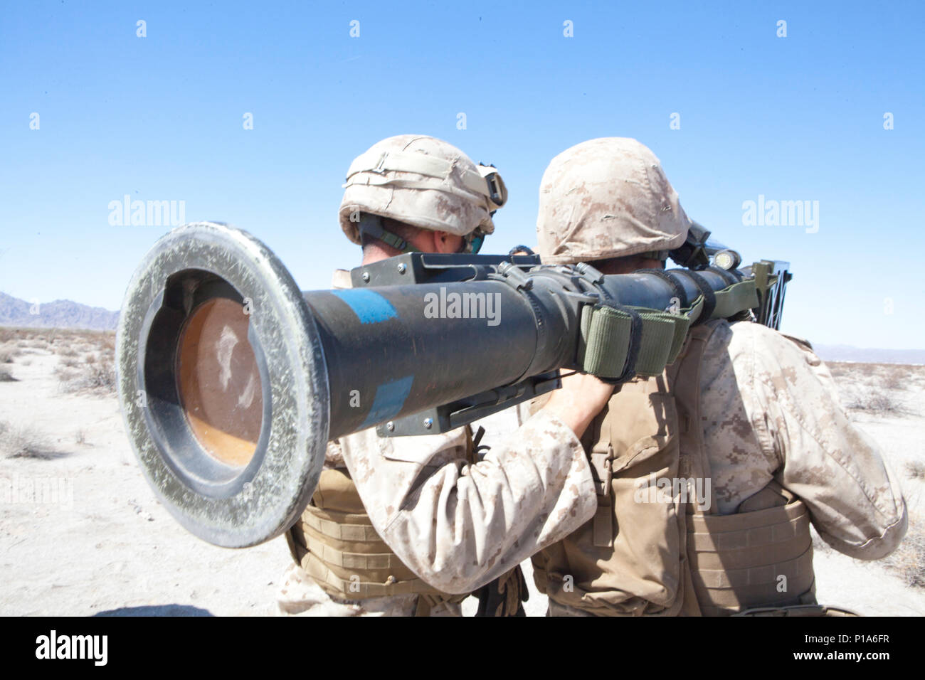 U.S. Marine Corps Cpl. Brandon Stewart and Lance Cpl. Pierre Ponce, low altitude air defense (LAAD) gunners with 2nd LAAD Battalion demonstrate the use of a FIM-92 Stinger during a ground based air defense exercise in support of Weapons and Tactics Instructor Course (WTI) 1-17 at Site 50, Wellton, Ariz., Oct. 6, 2016. WTI is a seven week training event, hosted by Marine Aviation Weapons and Tactics Squadron One (MAWTS-1) cadre, which emphasizes operational integration of the six functions of Marine Corps aviation in support of a Marine Air Ground Task Force. MAWTS-1 provides standardized advan - Stock Image