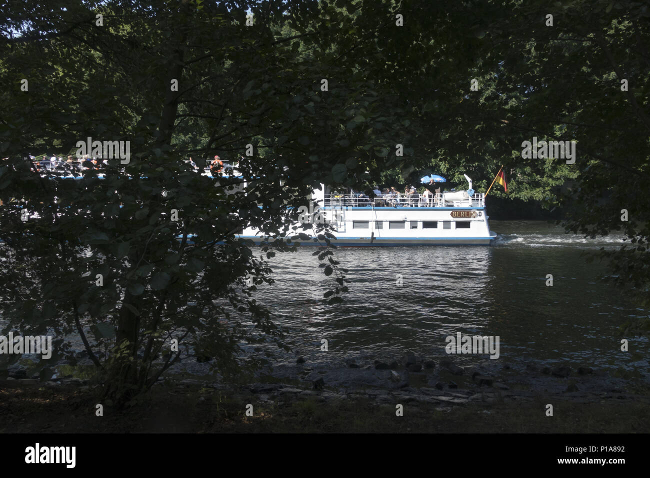Berlin, Germany, Passenger ship travels through a canal - Stock Image
