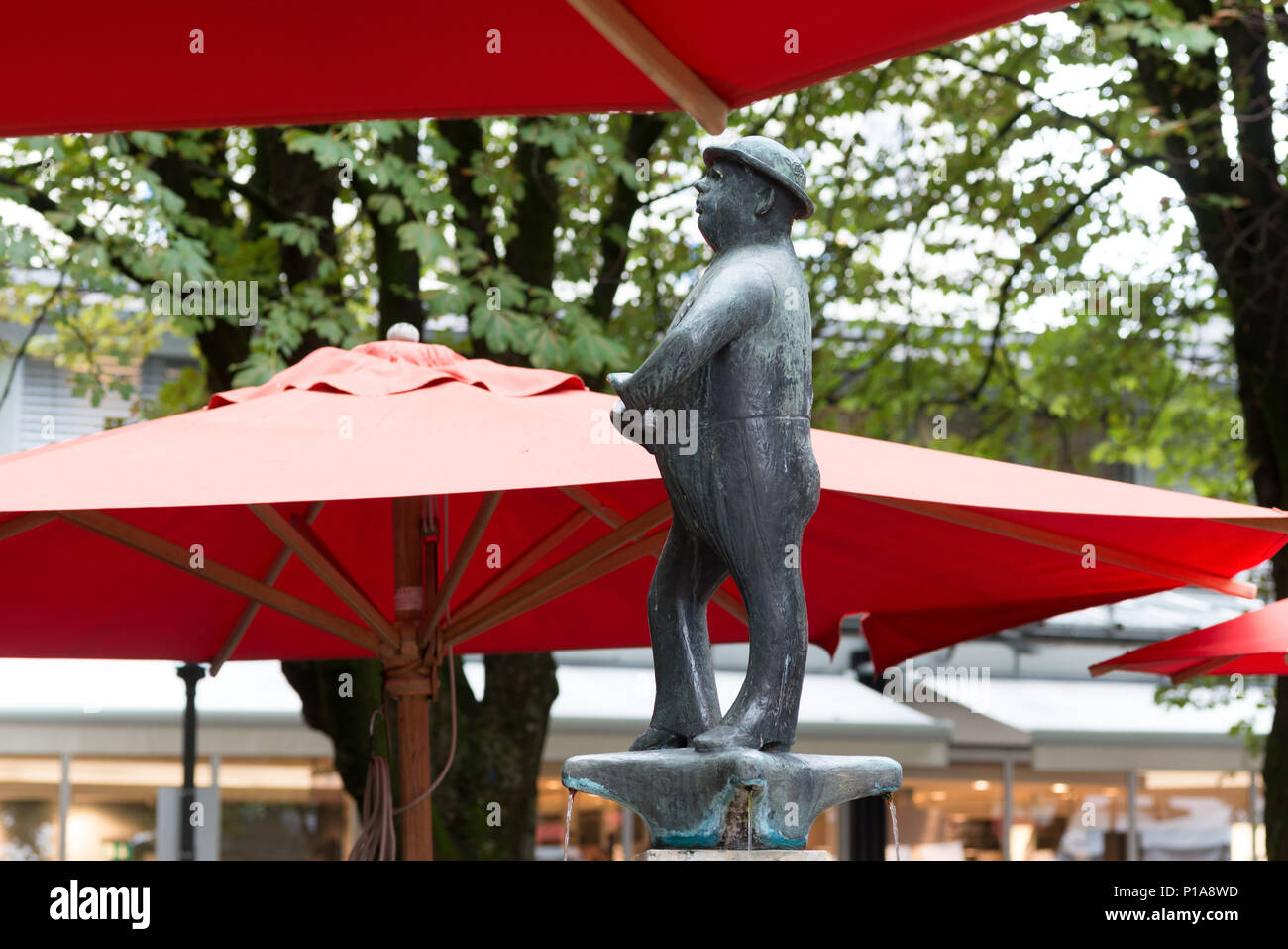 Muenchen, Germany, fountain with the figure of Weissferdl on the Viktualienmarkt - Stock Image