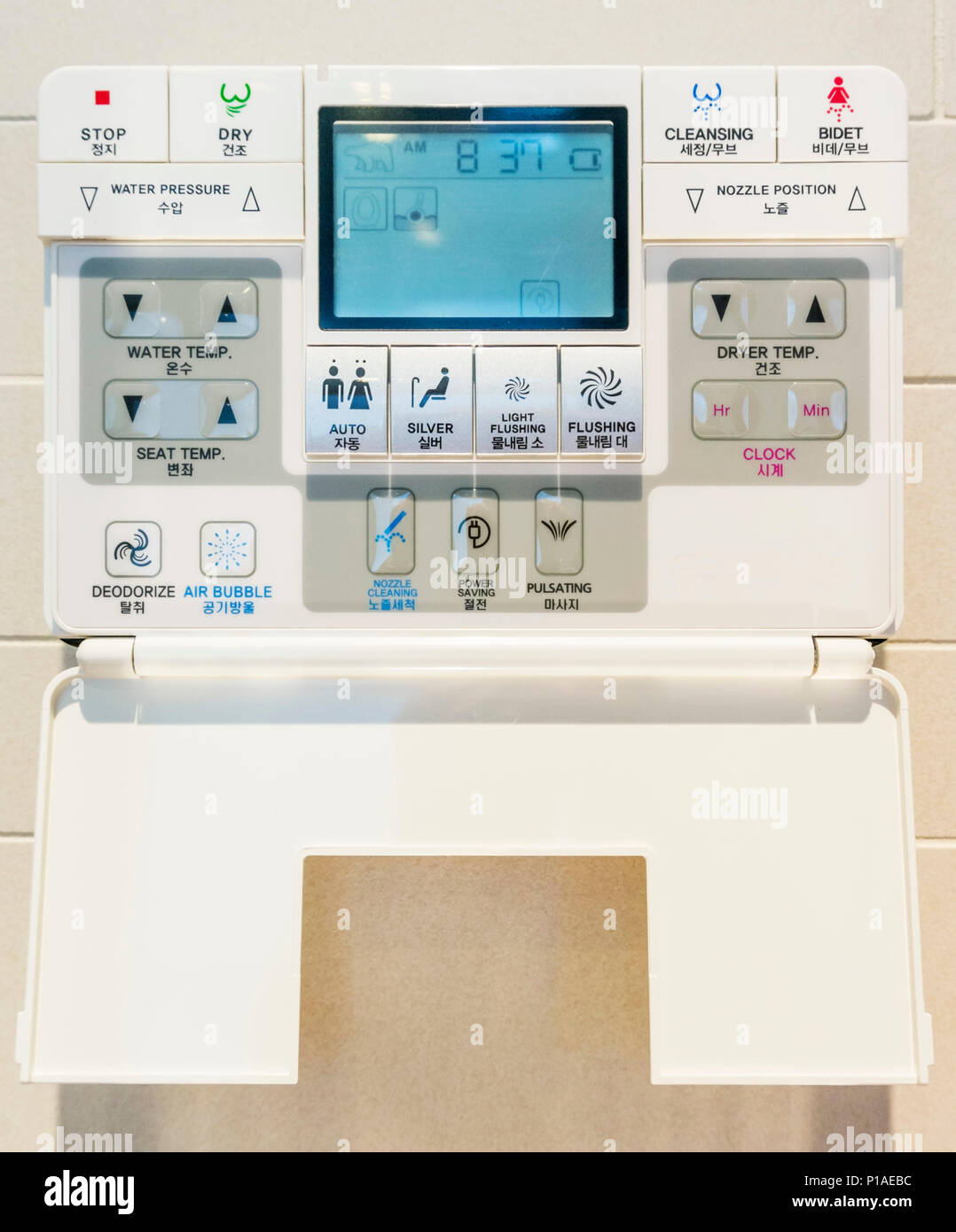 japanese style modern toilet with bidet wash function smart toilet automatic flushing with various washing functions wall control panel - Stock Image