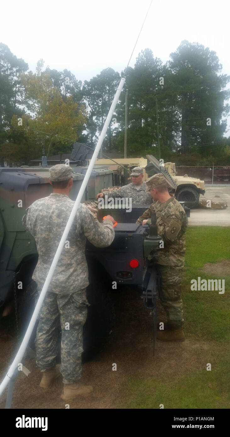 Soldiers from A Co, 1-252 Armor Regiment, 30th Armored Brigade Combat Team (ABCT), conduct pre-checks on tactical vehicles in Eastern North Carolina for the Hurricane Matthew State Active Duty support on Oct. 6, 2016. Stock Photo