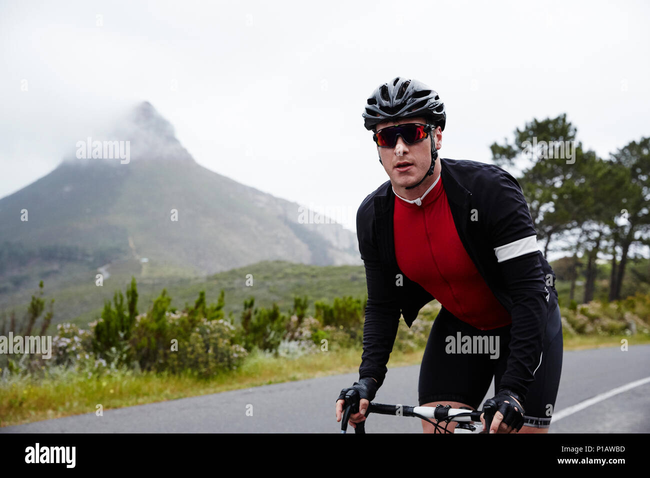 Portrait confident, determined male cyclist cycling on road Stock Photo