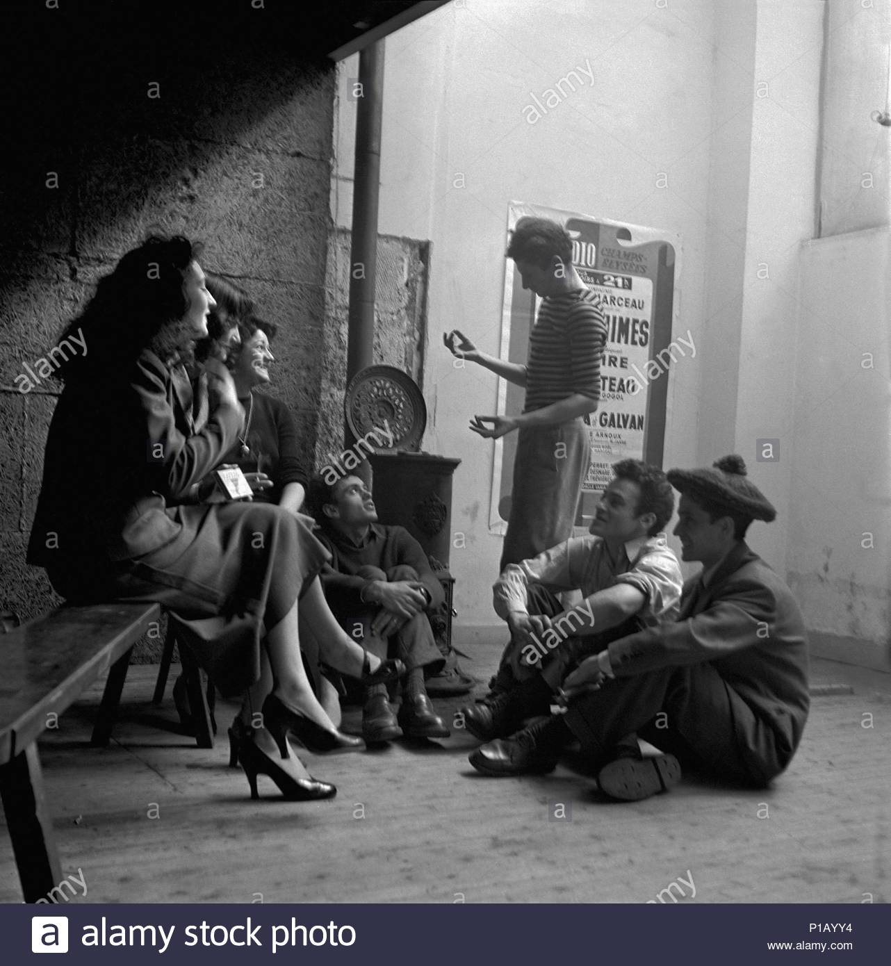 Marcel Marceau, the French mime who created the character 'Bip'. Marceau talking to his crew about a new project. Paris, 1951. Location: Townscape, Paris, France. - Stock Image