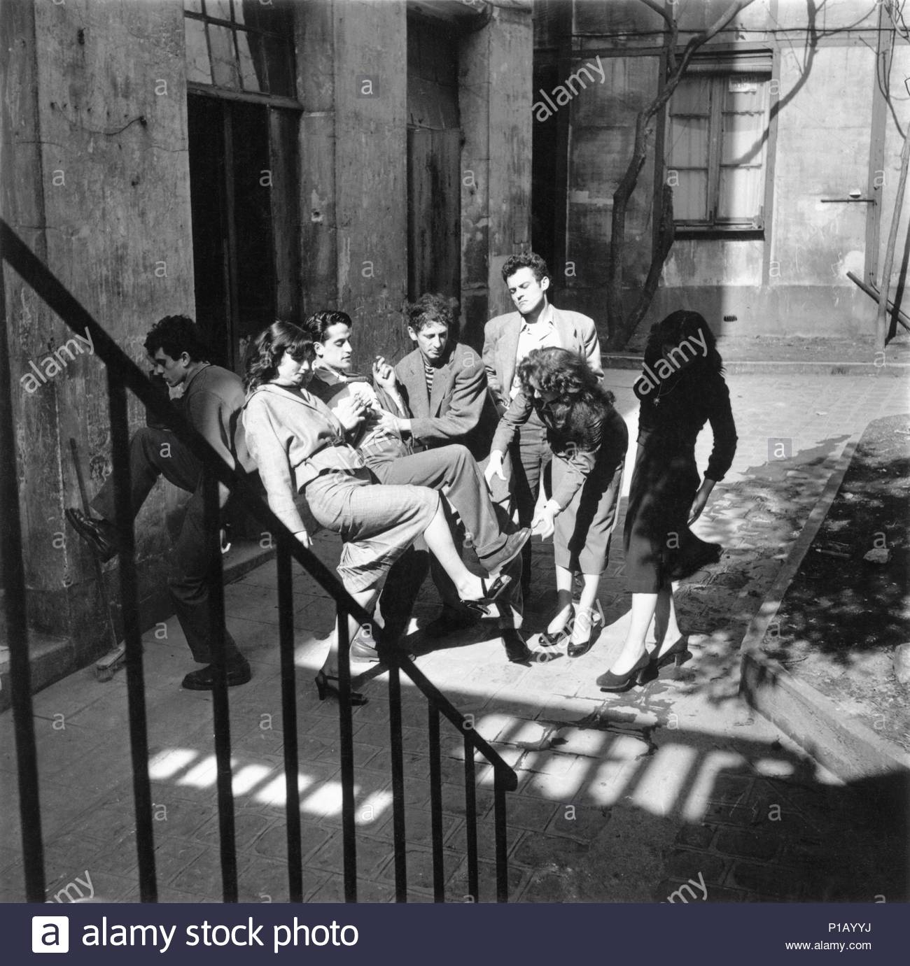 Marcel Marceau, the French mime who created the character 'Bip'.   Marceau rehearsing with his actors.   Paris, 1951. Location: Townscape, Paris, France. - Stock Image