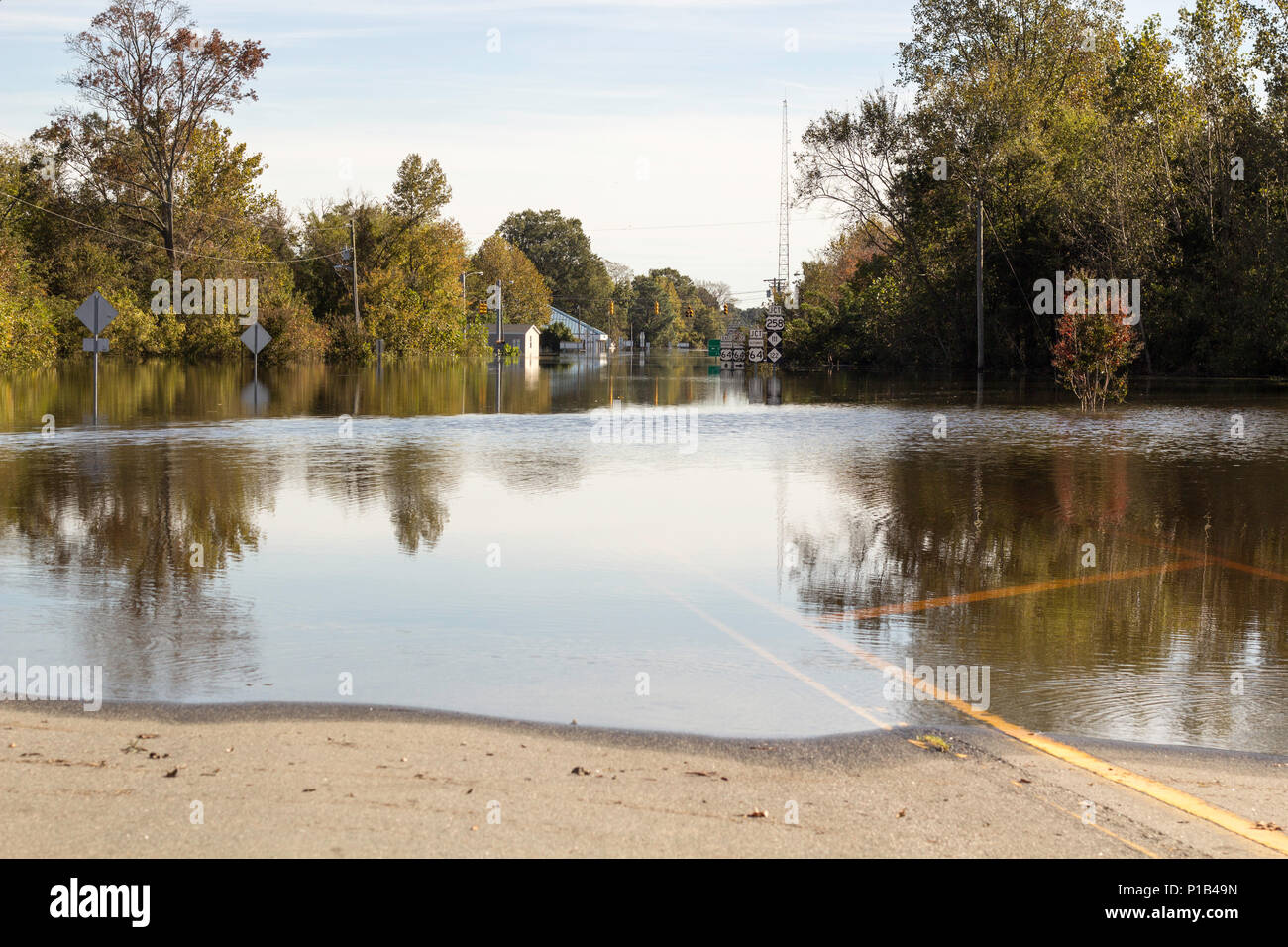 Twenty feet of water covers Princeville, North Carolina, in the week following Hurricane Matthew, on October 15, 2016. This historic town saw similar flooding during Hurricane Floyd in 1999. The North Carolina National Guard is assisting in the aftermath of Hurricane Matthew by beginning pumping operations that will pump one million gallons of water an hour into the Tar River and away from Princeville. - Stock Image