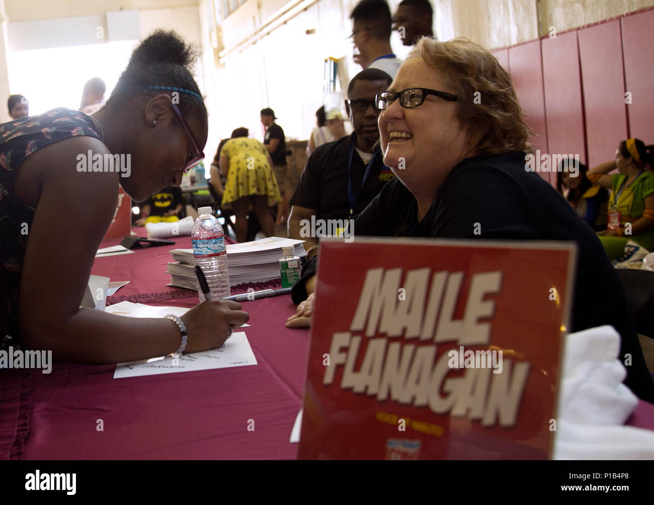 Maile Flanagan socializes with fans while signing autographs October 15 during Comic Con on Camp Foster, Okinawa, Japan. Comic Con is an annual gathering of comic book connoisseurs, video gamers, movie fans and artists across the island that participate in featured events such as: Pokémon tournaments, video game showdowns, cosplay and art contests, panel discussion and meet and greets with guest artists and voice actors. Flanagan is best known as the English a voice actor of Naruto, of the hit animated series. (U.S. Marine Corps photo by Cpl. Brittany A. James / Released) - Stock Image