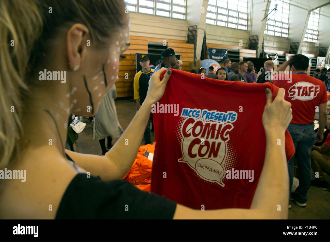 A Comic Con Attendee Views A T Shirt October 15 During Comic Con On