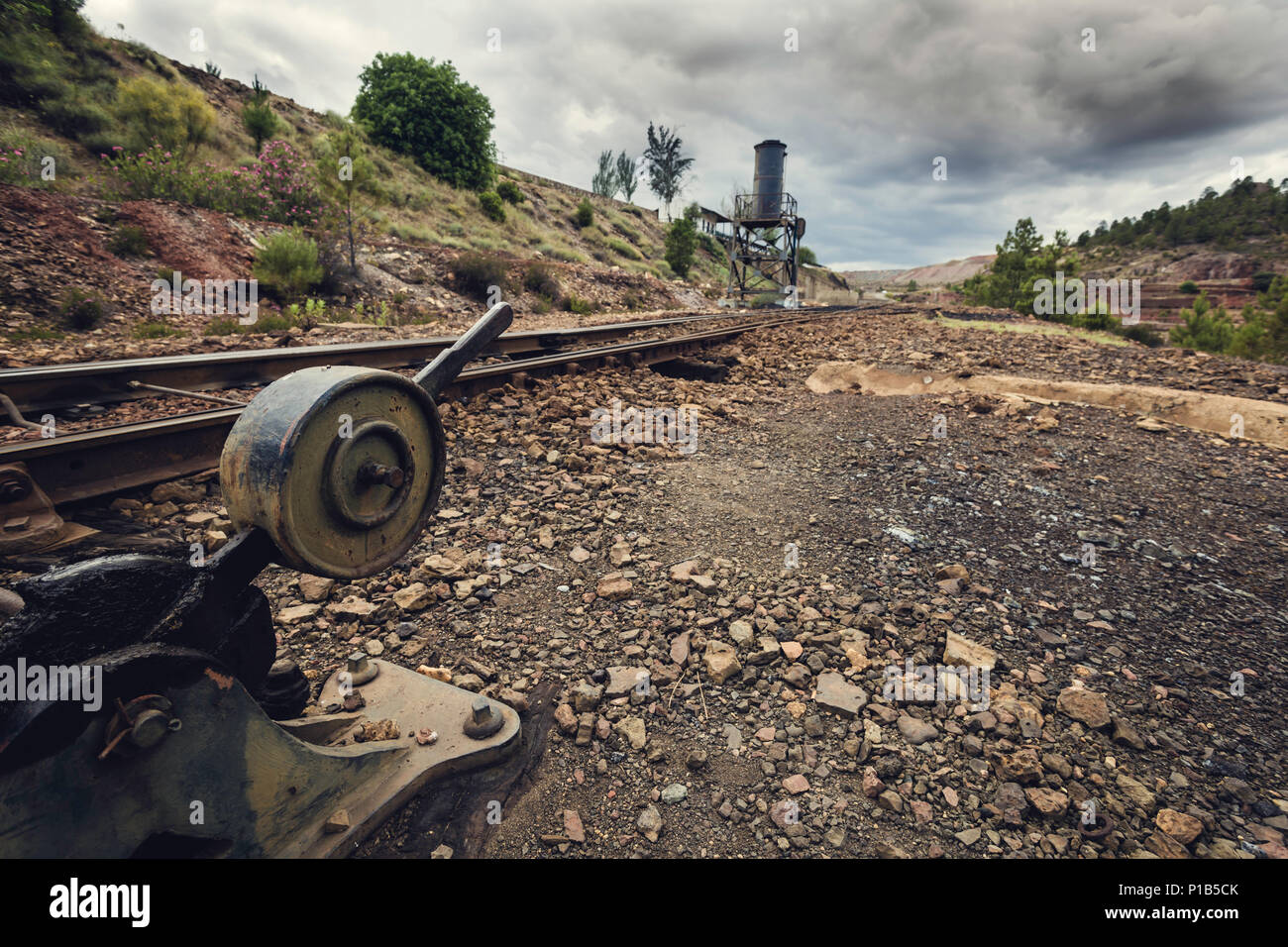 Old lever for changing trains on a stormy day, in the old station of Zarandas, Spain - Stock Image