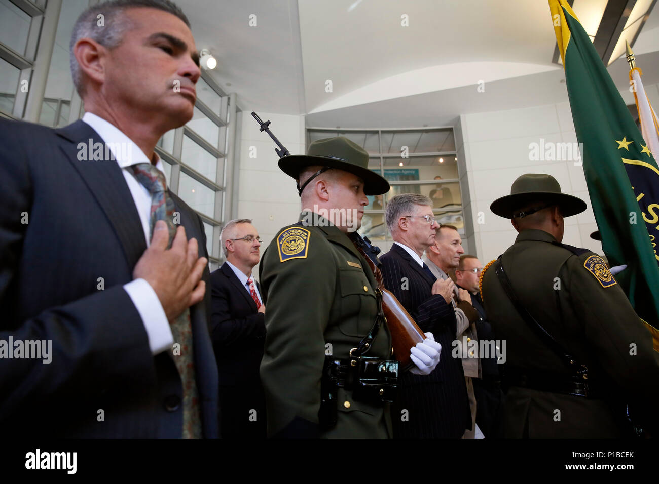 Members of the U.S. Patrol color guard enter the hall shortly before U.S. Customs and Border Protection Commissioner R. Gil Kerlikowske swears-in newly appointed Chief of U.S. Border Patrol Mark Morgan during a ceremony at the Ronald Reagan Building in Washington, D.C., October 11, 2016. CBP Photo by Glenn Fawcett - Stock Image