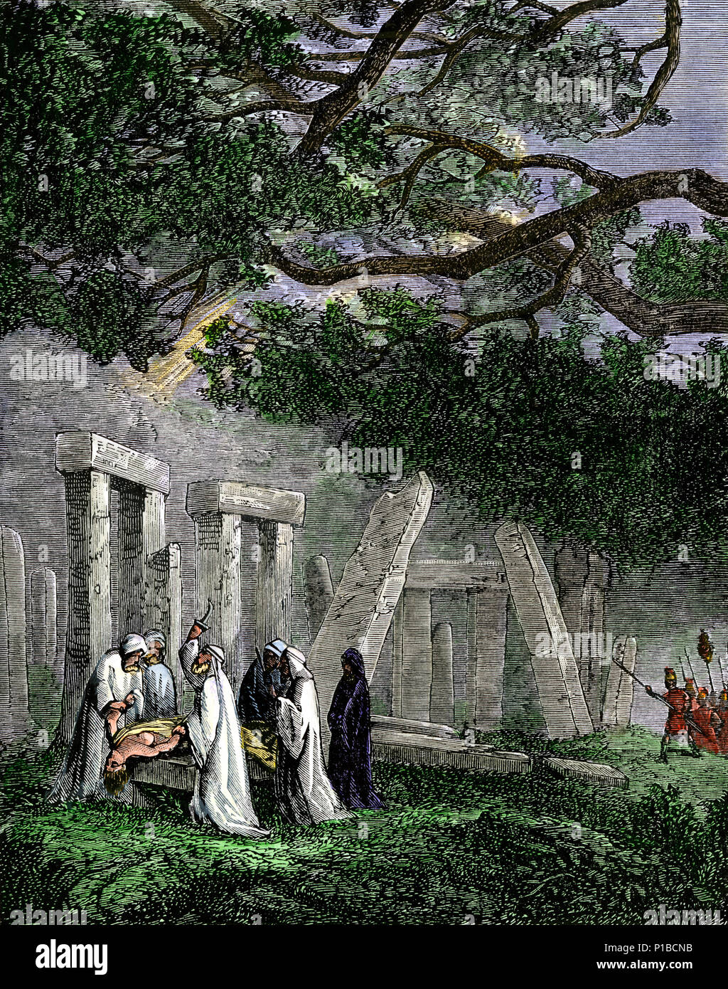 Druid human sacrifice at Stonehenge stopped by Roman soldiers. Hand-colored woodcut - Stock Image
