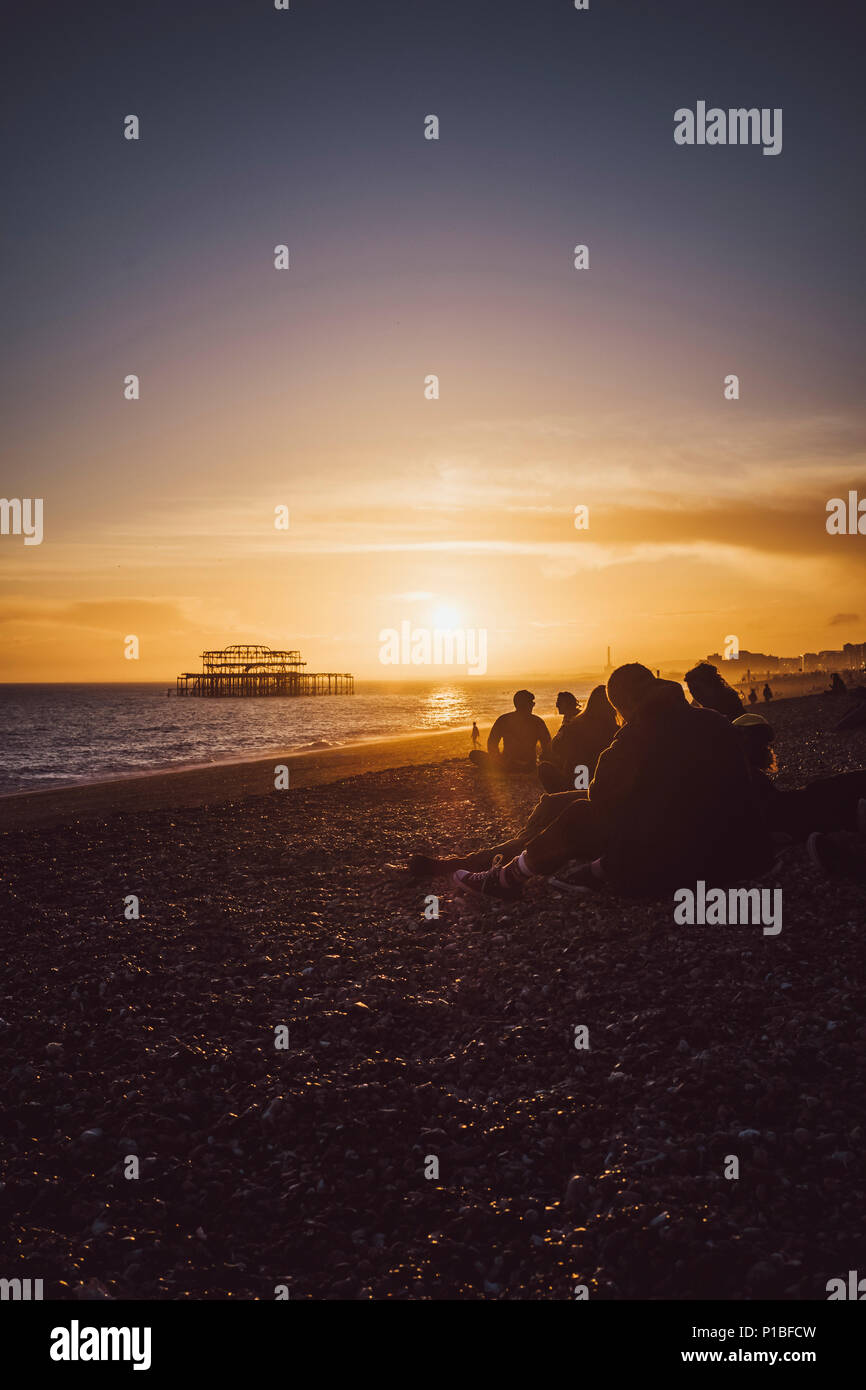 Burned West Pier by the sea, Brighton, England Stock Photo