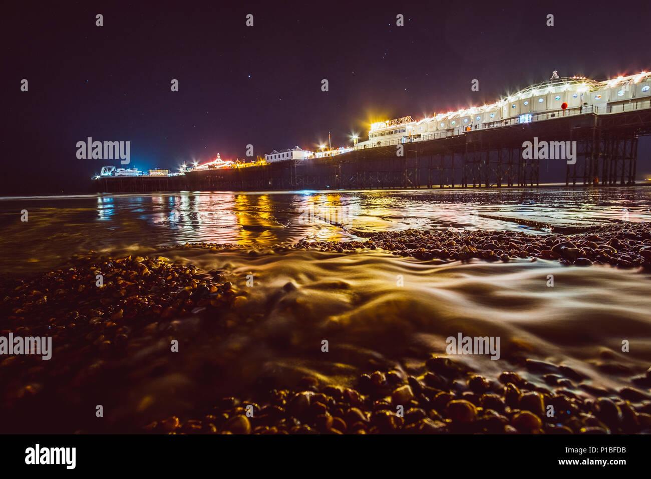 Brighton pier at night, Brighton, England - Stock Image
