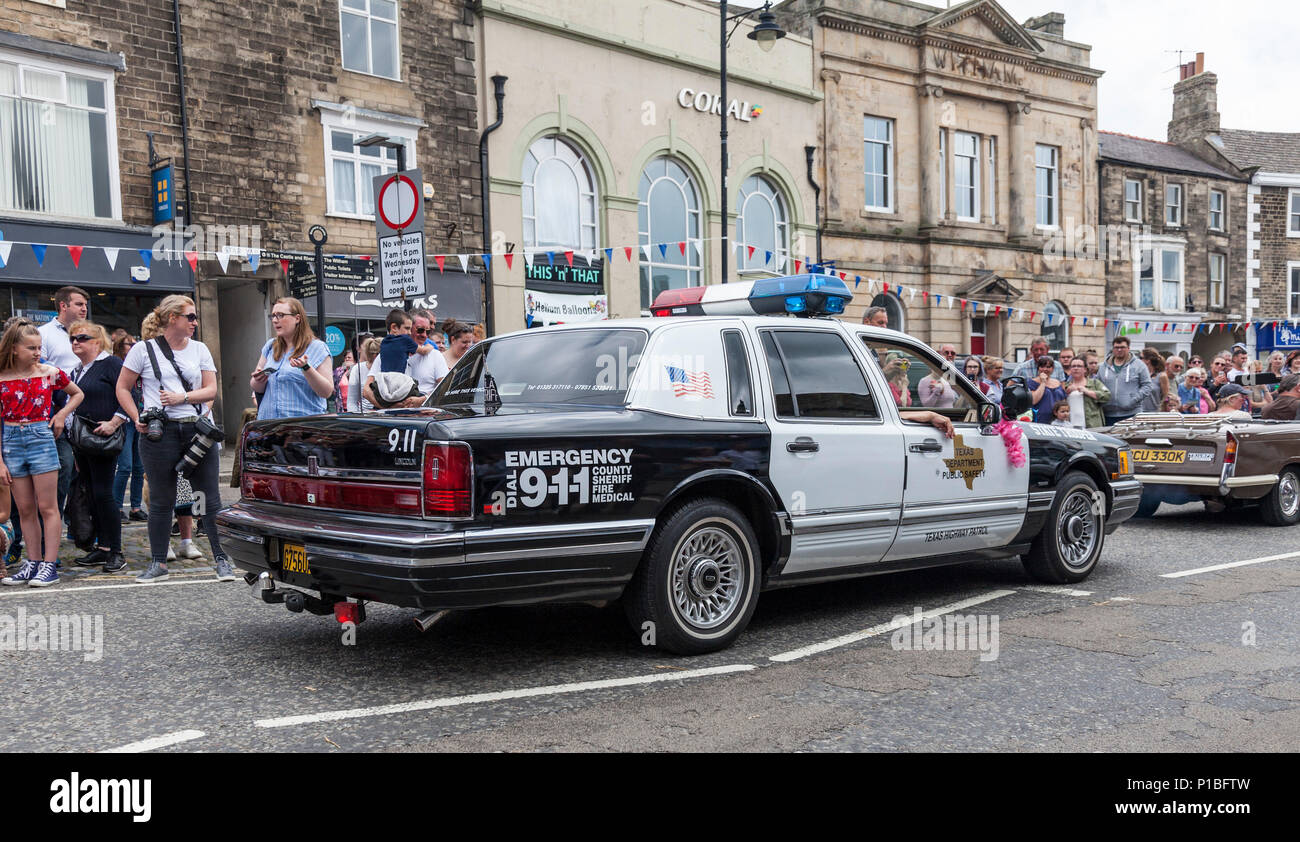 A Lincoln Us Police Car In The Parade Of Cars Through Barnard Castle