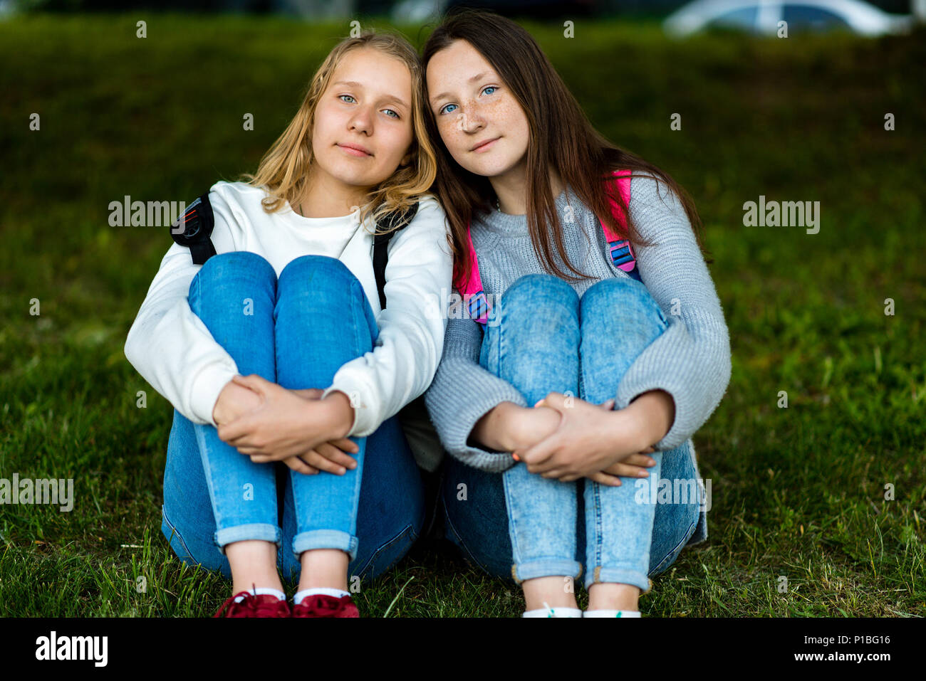 Two Teenage Girl Summer In Nature They Are Sitting On Grass Communicate With Each Other To Pose On The Camera Best Friends Privacy From Adults Stock Photo Alamy Are you looking best photography poses for girl? https www alamy com two teenage girl summer in nature they are sitting on grass communicate with each other to pose on the camera best friends privacy from adults image207393122 html