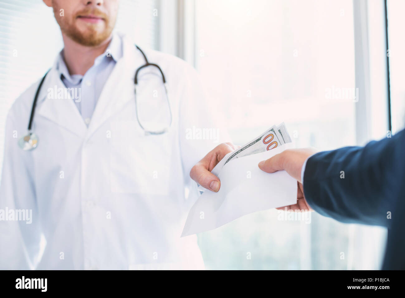 Content doctor taking a substantial bribe - Stock Image
