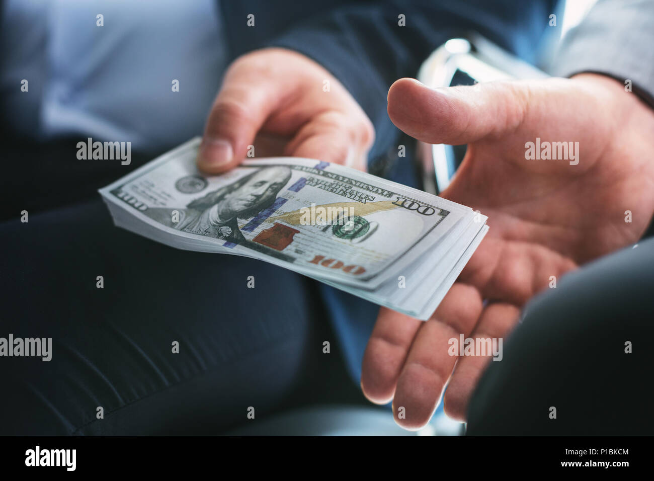 Immoral rich businessman giving a bribe Stock Photo