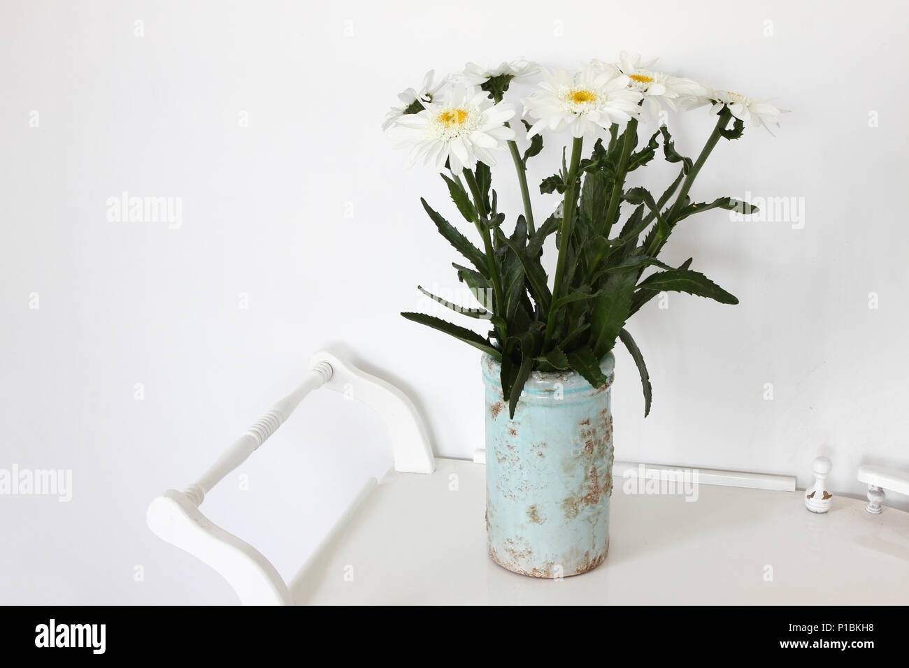 Still life with vase with chamomile flowers daisy flowers bouquet still life with vase with chamomile flowers daisy flowers bouquet in clay vase on white wooden shabby table flower background floral pattern izmirmasajfo
