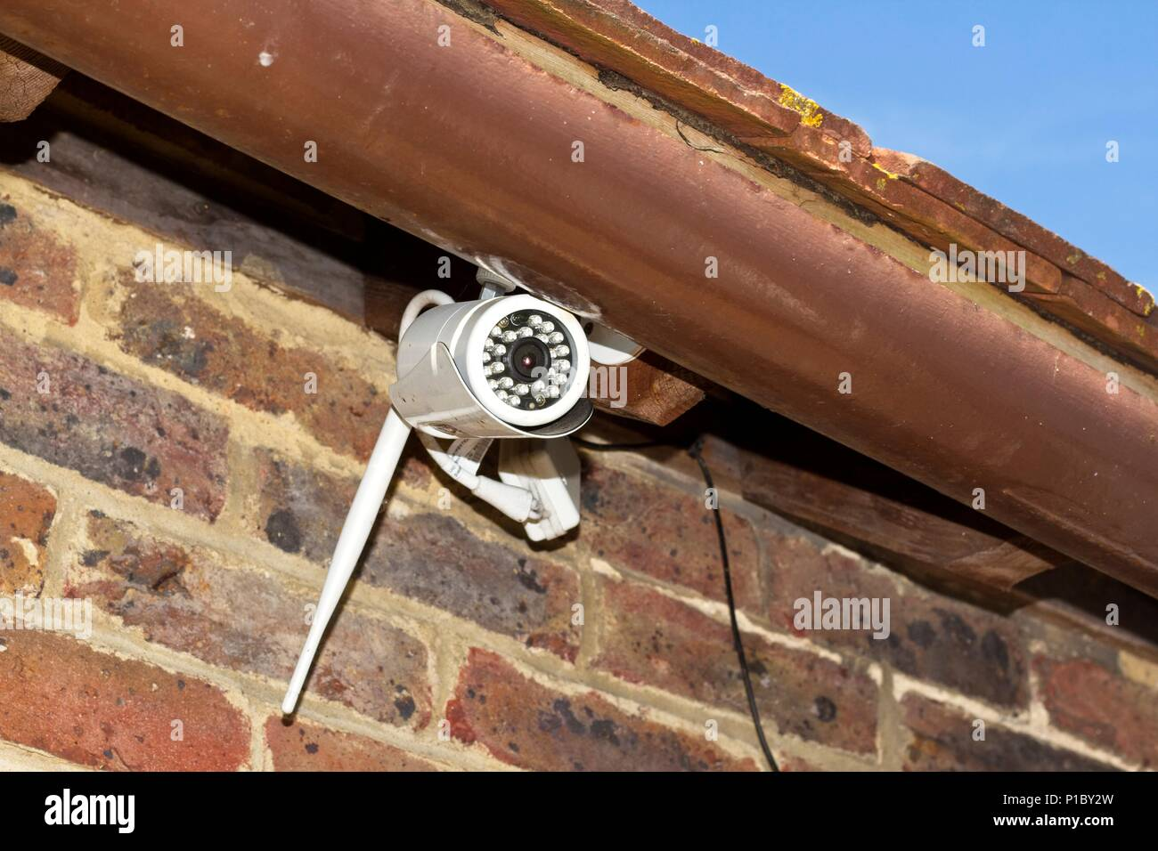 CCTV camera on outside of house, East Sussex, UK Stock Photo