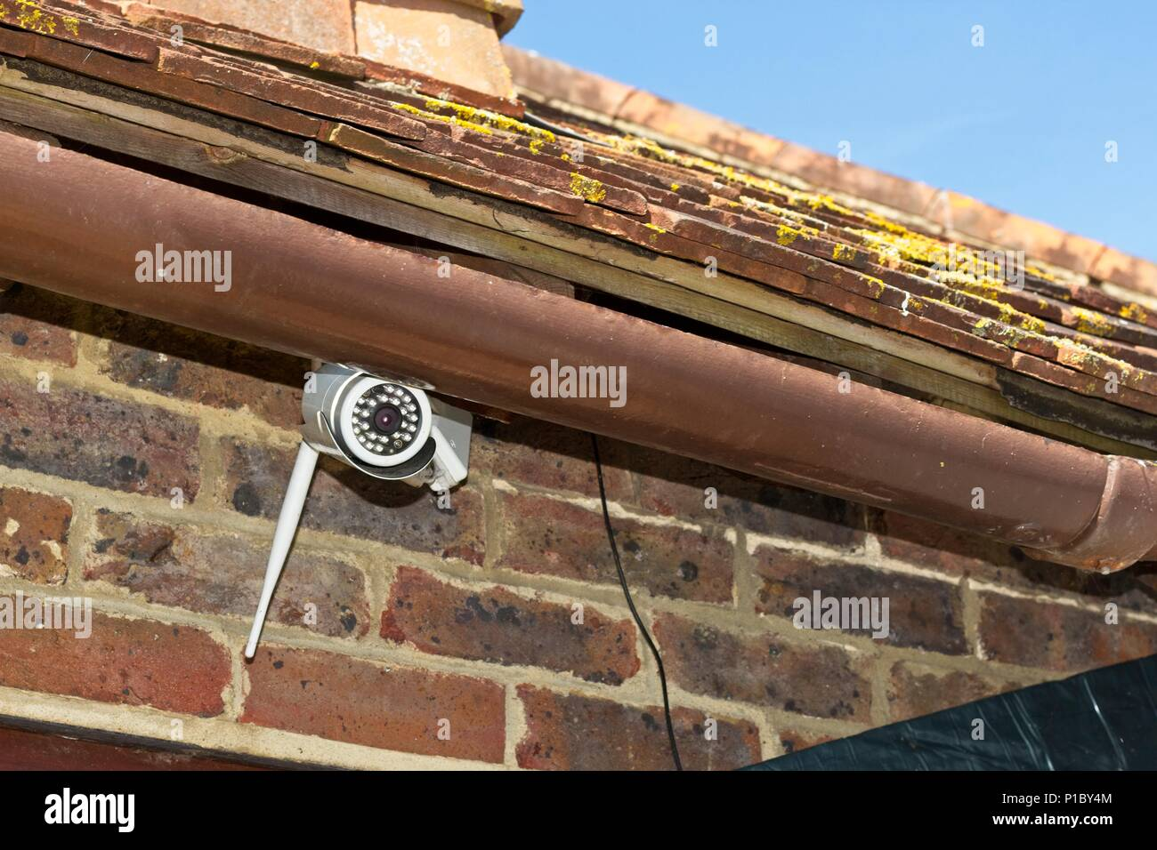 CCTV camera on outside of house, East Sussex, UK - Stock Image
