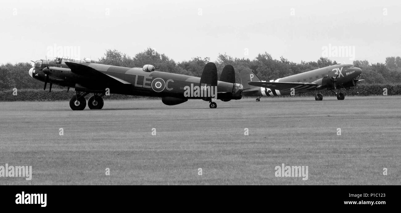 lancaster bomber in grass airfield with C47 - Stock Image