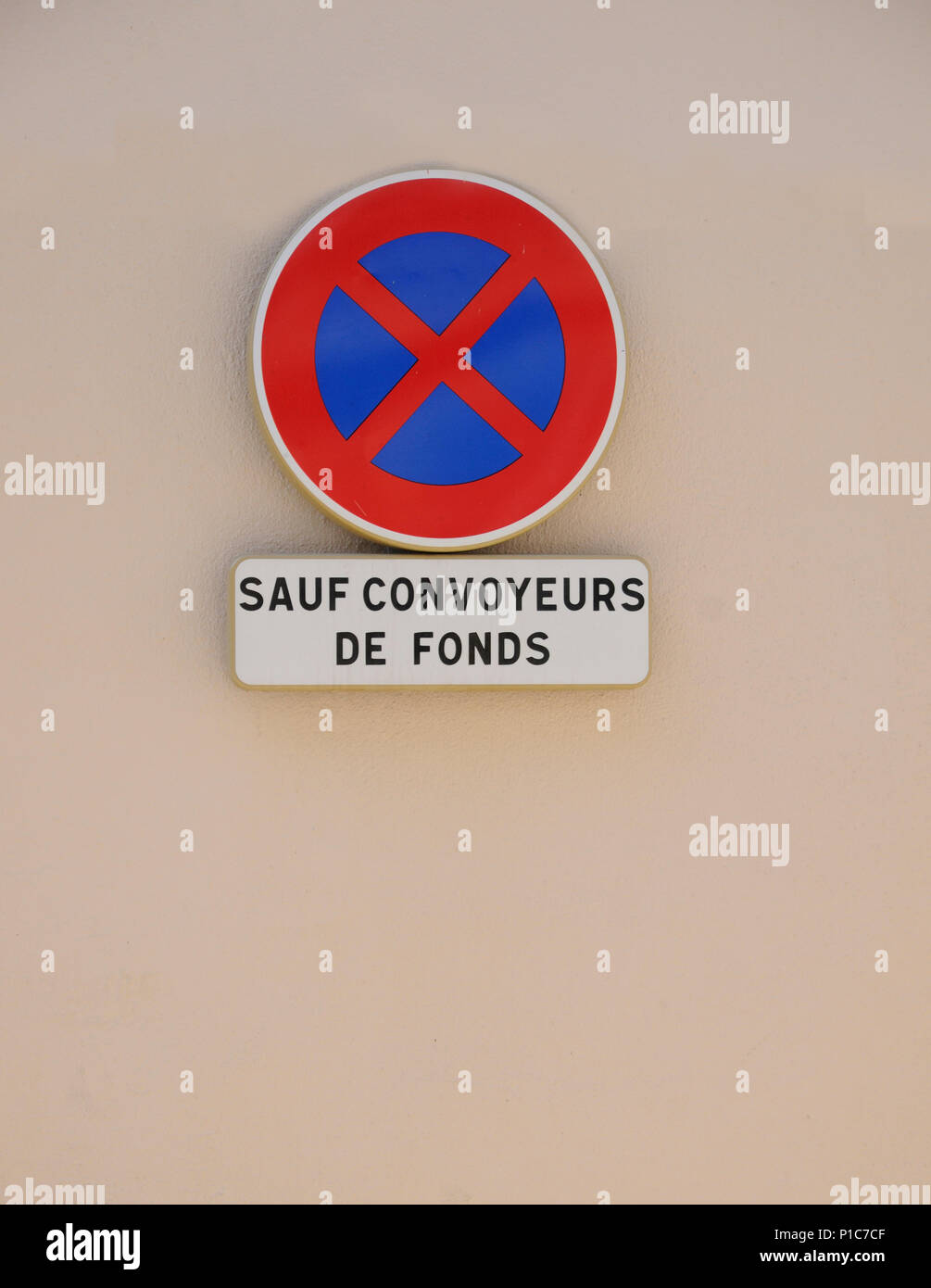 Traffic sign reading SAUF CONVOYEURS DE FONDS forbidding traffic to stop except for vehicles delivering funds of money to bank  TRAFFIC SIGN SAUF CON Stock Photo