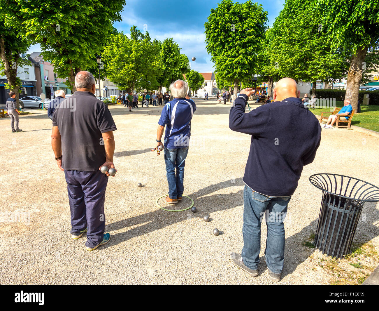 Men playing boules in market square, La Roche Posay, France. - Stock Image