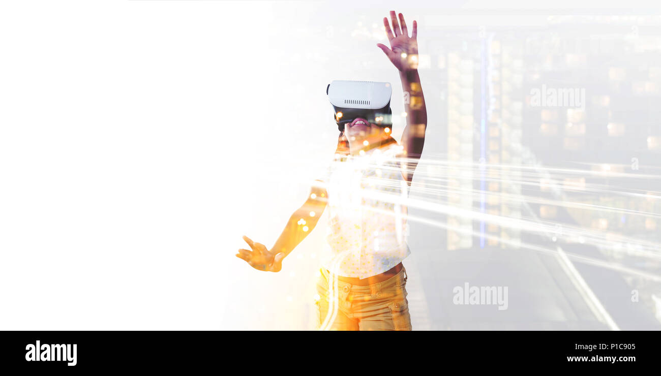 Girl wearing virtual reality simulator - Stock Image