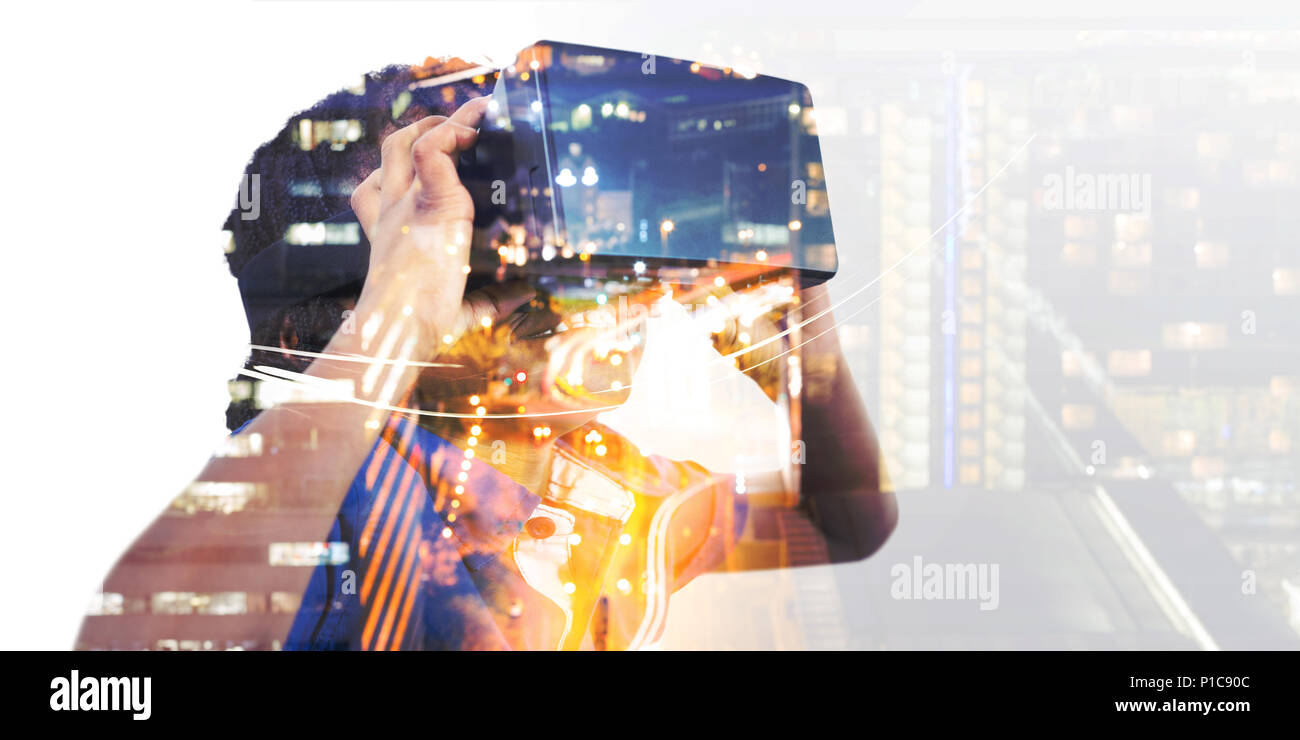 Boy wearing virtual reality simulator - Stock Image