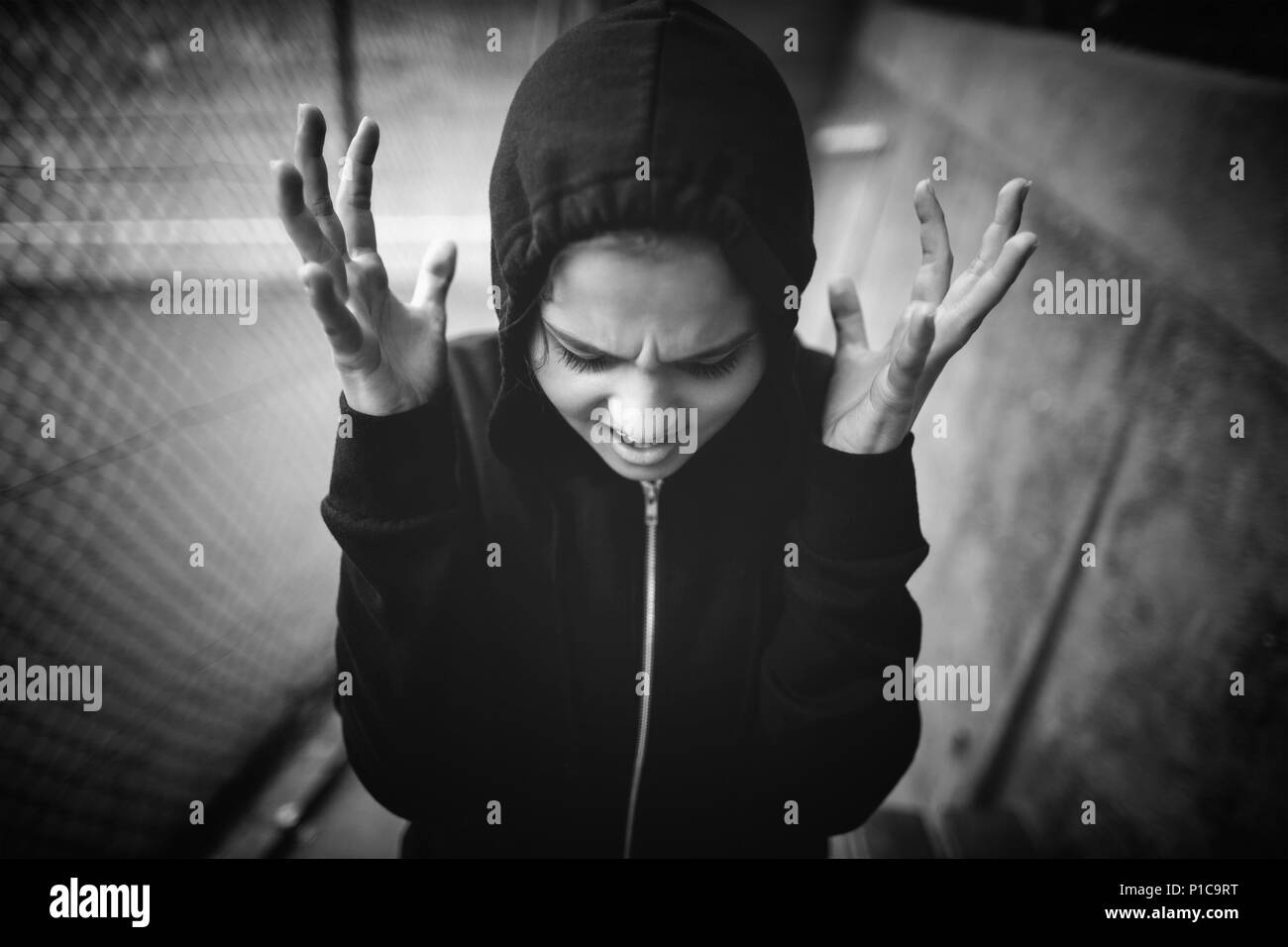Angry teenage girl standing at school campus - Stock Image