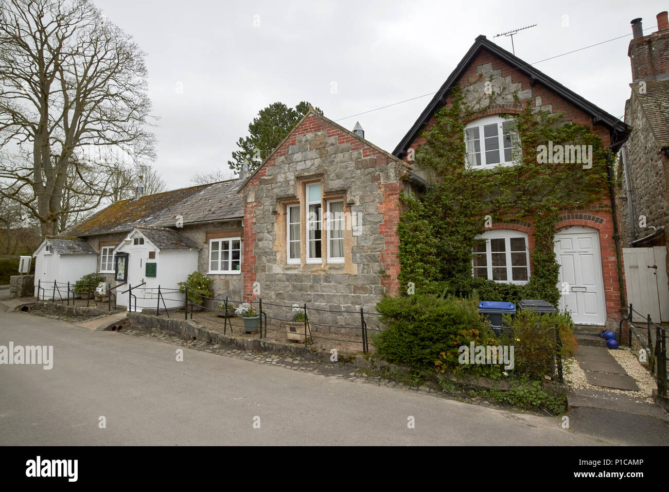 former village school and teachers cottage now social centre and accommodation avebury wiltshire england uk - Stock Image