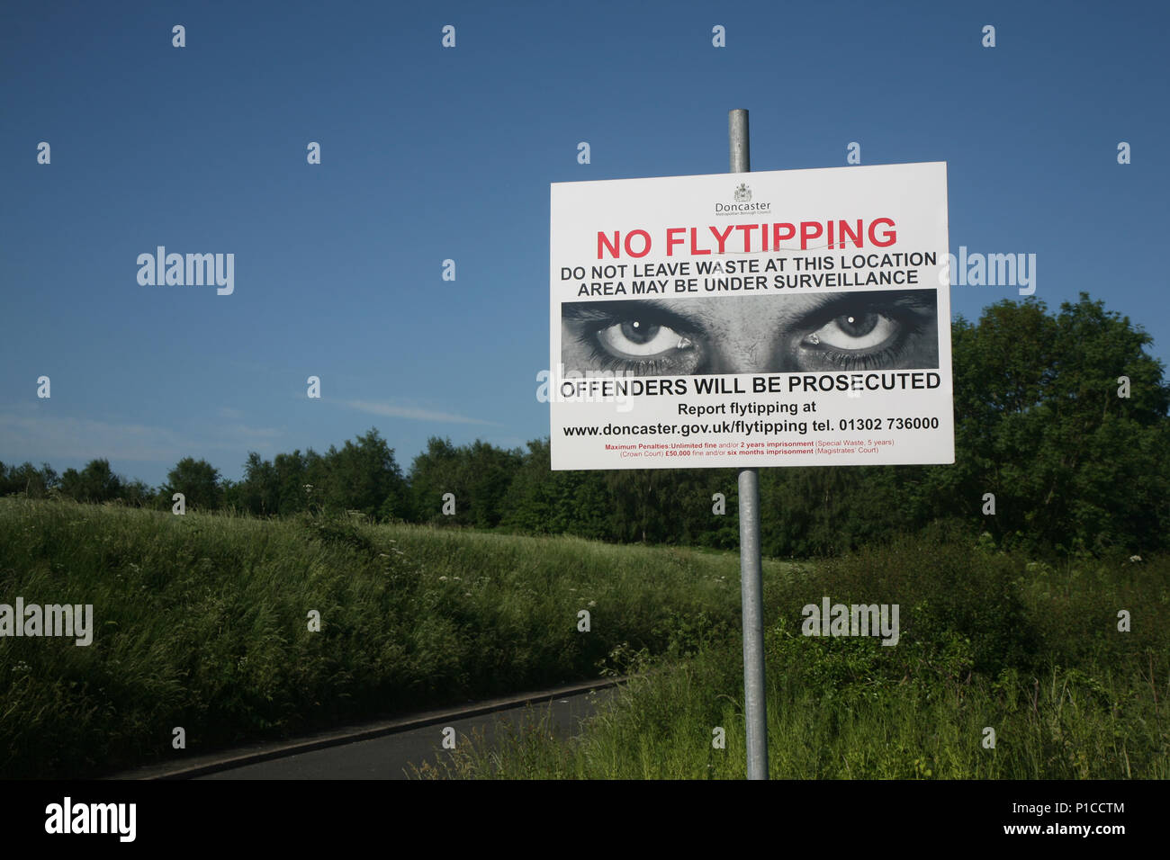No fly tipping sign seen here near a very active illegal tipping place on Tickhill Road on the A631 on the outskirts of Bawtry, South Yorkshire, UK - Stock Image