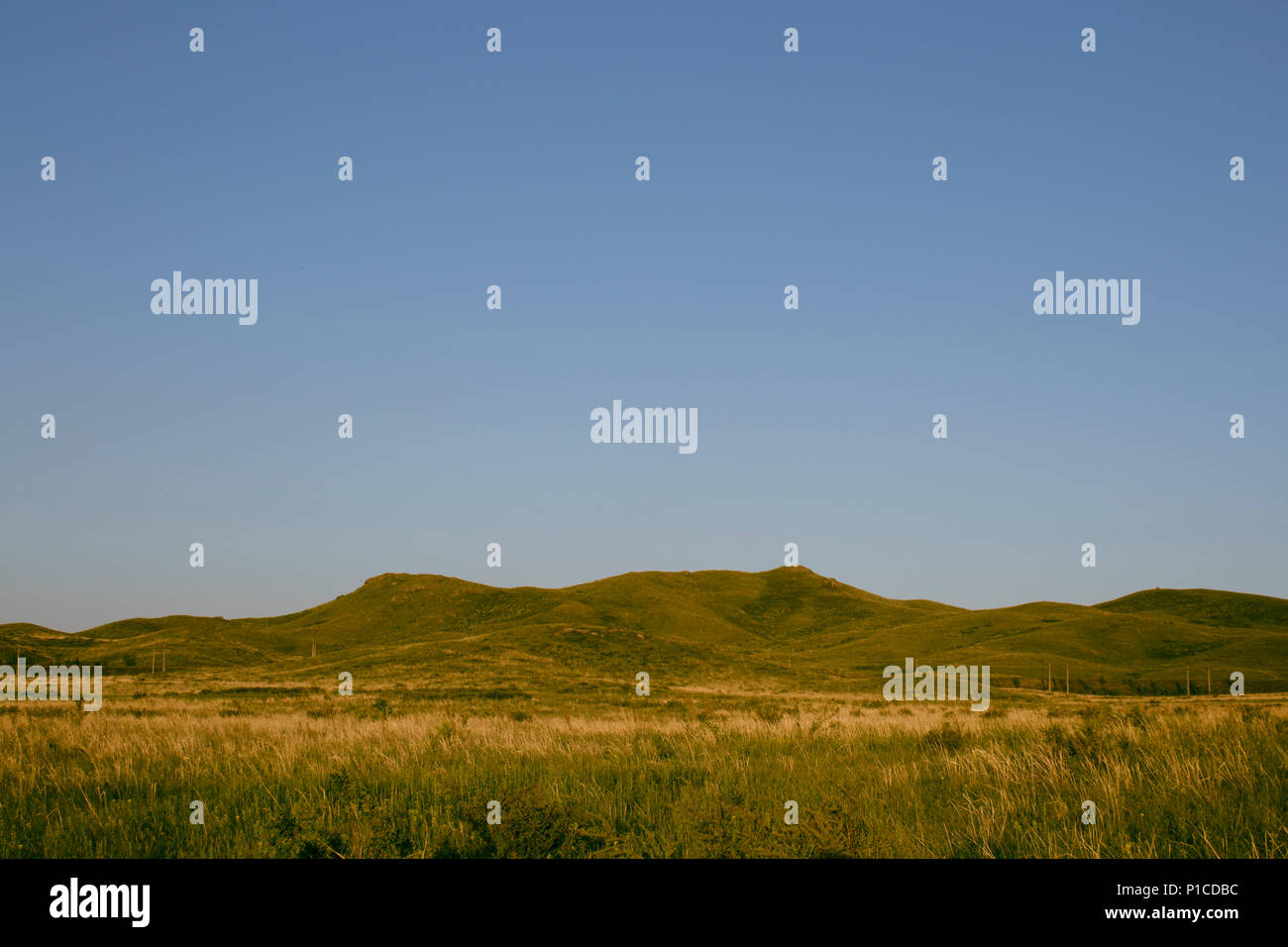 Evening hills. Natural scenery. Summer background. Steppe horizon. - Stock Image