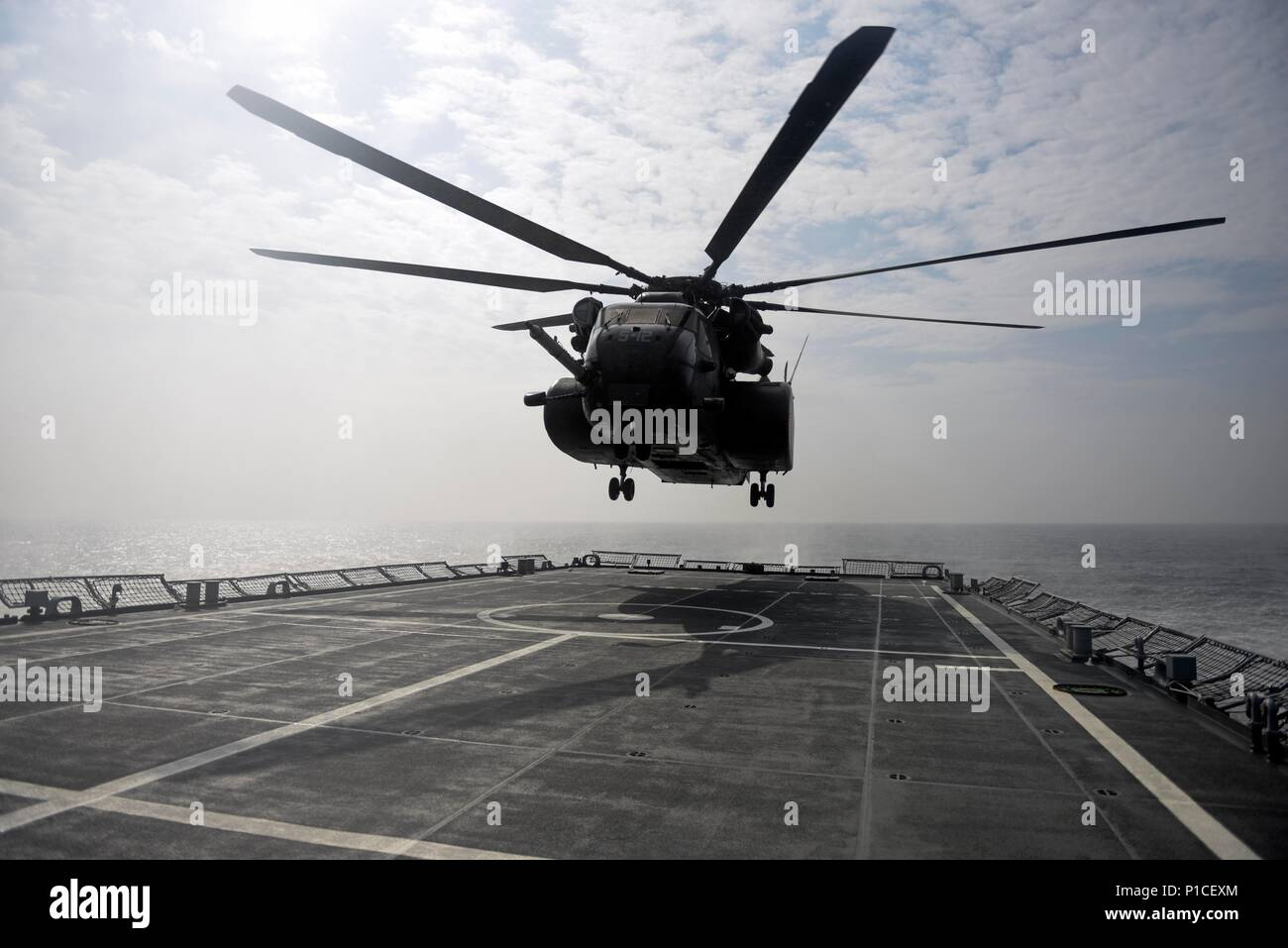 161018-N-WT427-199 WATERS EAST OF THE KOREAN PENINSULA, Republic of Korea (Oct. 18, 2016) An MH-53E Sea Dragon helicopter from Helicopter Squadron (HM) 14, approaches the Republic of Korea (ROK) mine laying ship ROKS Wonsan (MLS 560), during exercise Clear Horizon. Exercise Clear Horizon is an annual bilateral exercise between the U.S. and Republic of Korea navies that focus on increasing capabilities and coordination between ships and aircraft in mine countermeasures in international waters surrounding the Korean peninsula. (U.S. Navy photo by Petty Officer 2nd Class Jermaine M. Ralliford) Stock Photo