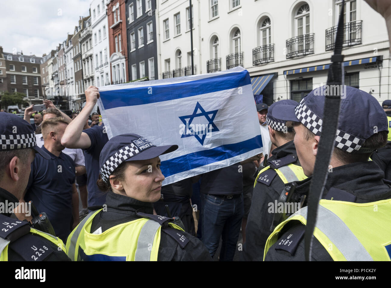 London, UK. 10th June, 2018. Opposition protesters hold an Israeli flag during the Al Quds Day rally.The Al Quds Day rally is an event which is supposed to highlight the plight of the Palestinian people and raise awareness of Islamic persecution around the world. The rally has caused controversy across the UK because speakers at the event openly call for the destruction of Israel and some participants wave the flag of Hezbollah, a proscribed terrorist group. Credit: Edward Crawford/SOPA Images/ZUMA Wire/Alamy Live News - Stock Image