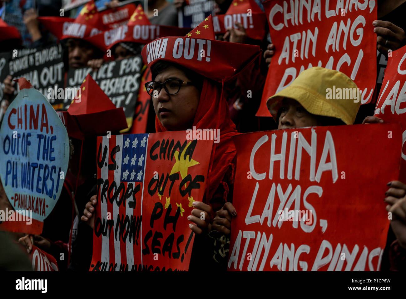 Manila, Philippines. 12th June, 2018. Filipino protesters carry placards as various militant groups protest in front of the Chinese consulate in Makati City, Philippines in celebration of the 120th Philippine Independence Day on Tuesday. June 12, 2018. The groups condemn the ongoing dispute between the Philippines and China in the South China Sea. Credit: Basilio H. Sepe/ZUMA Wire/Alamy Live News - Stock Image