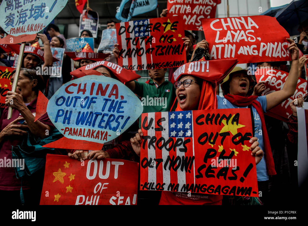 Manila, Philippines. 1st Jan, 2000. Various militant groups protest in front of the Chinese consulate in Makati City, Philippines in celebration of the 120th Philippine Independence Day on Tuesday. June 12, 2018. The groups condemn the ongoing dispute between the Philippines and China in the South China Sea. Credit: Basilio H. Sepe/ZUMA Wire/Alamy Live News - Stock Image